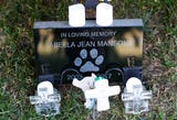Dog owner has spent about $14,000 at gravesite of his dog.