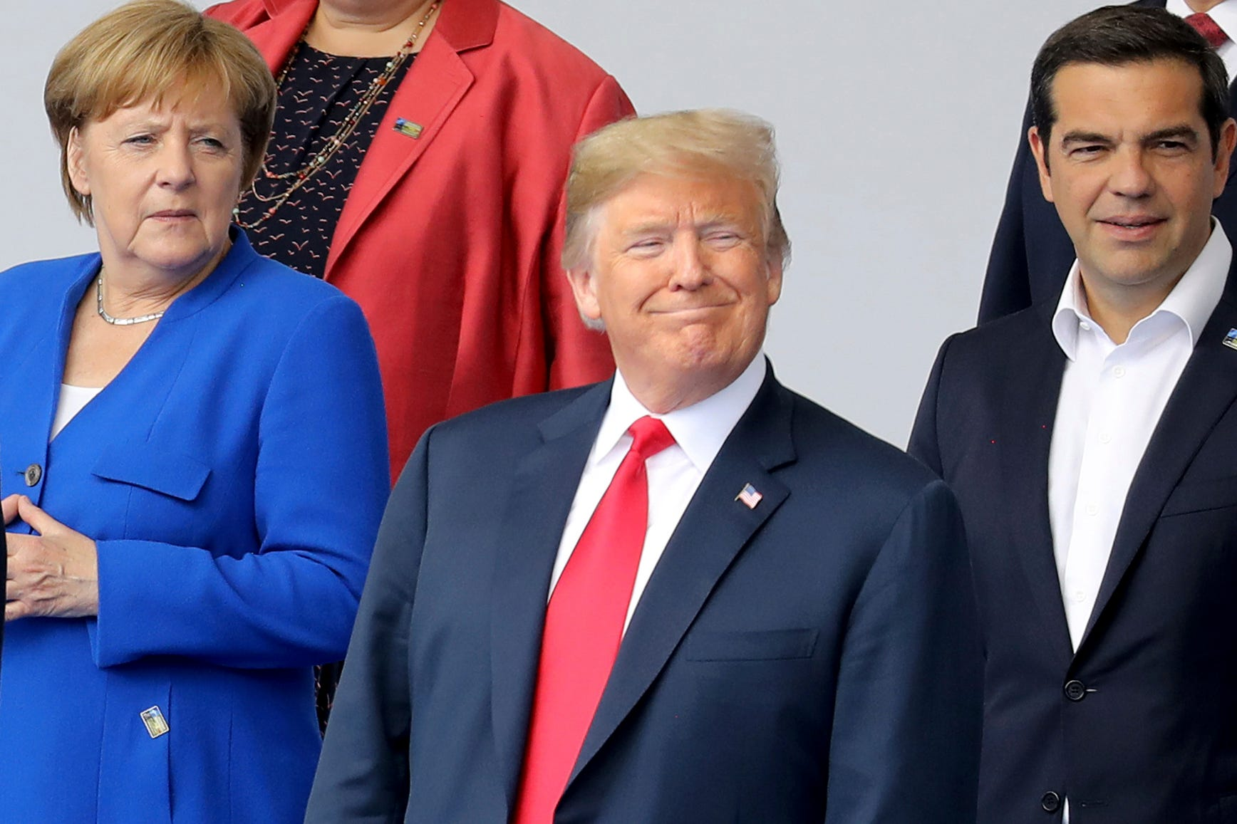 Trump says US won't pull out of NATO after receiving commitments from allies