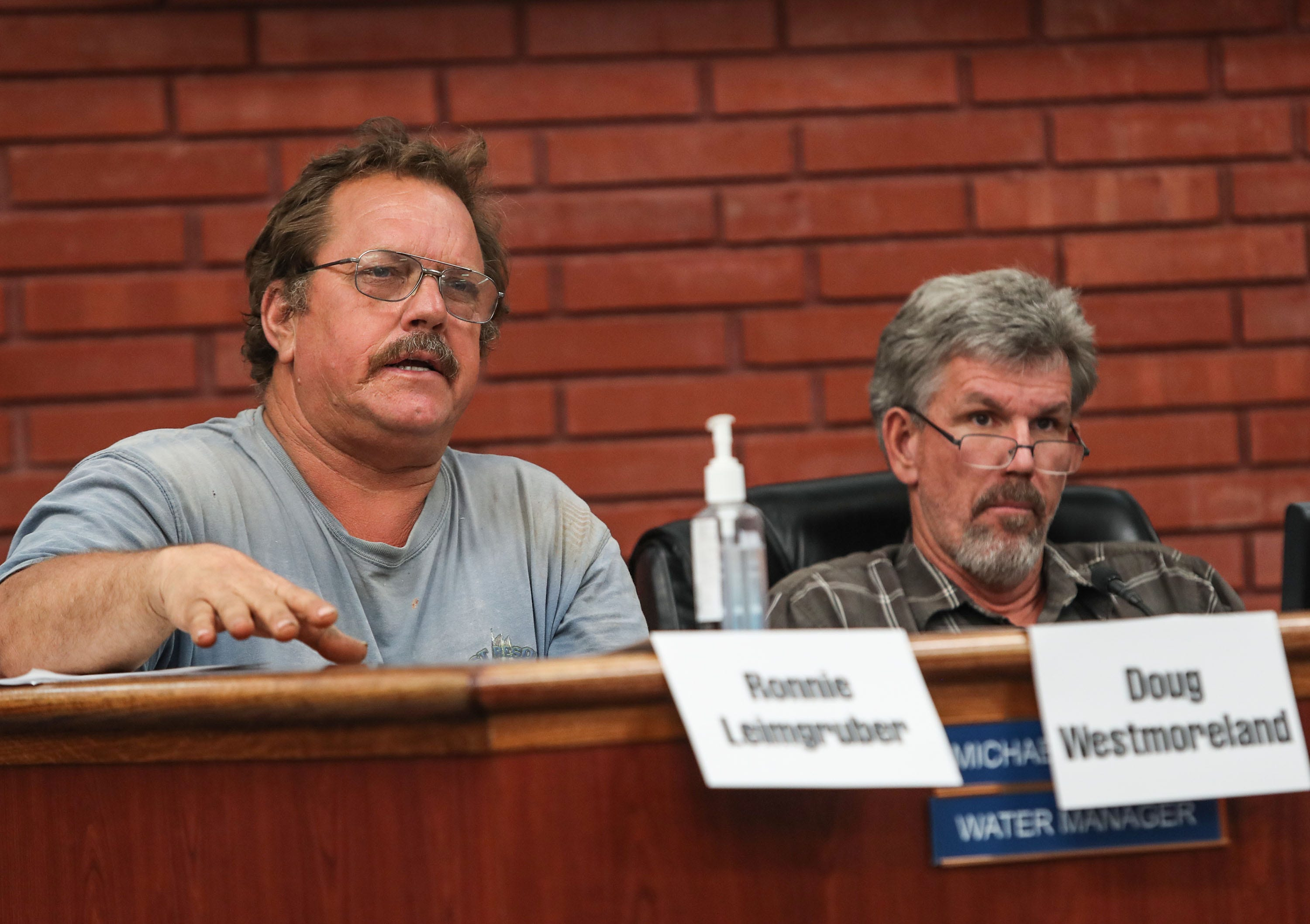 Ronnie Leimgruber, left, and Doug Westmoreland attend a meeting of the Imperial Irrigation District's Water Conservation Advisory Board in El Centro on July 12, 2018. Both men are members of the advisory board.