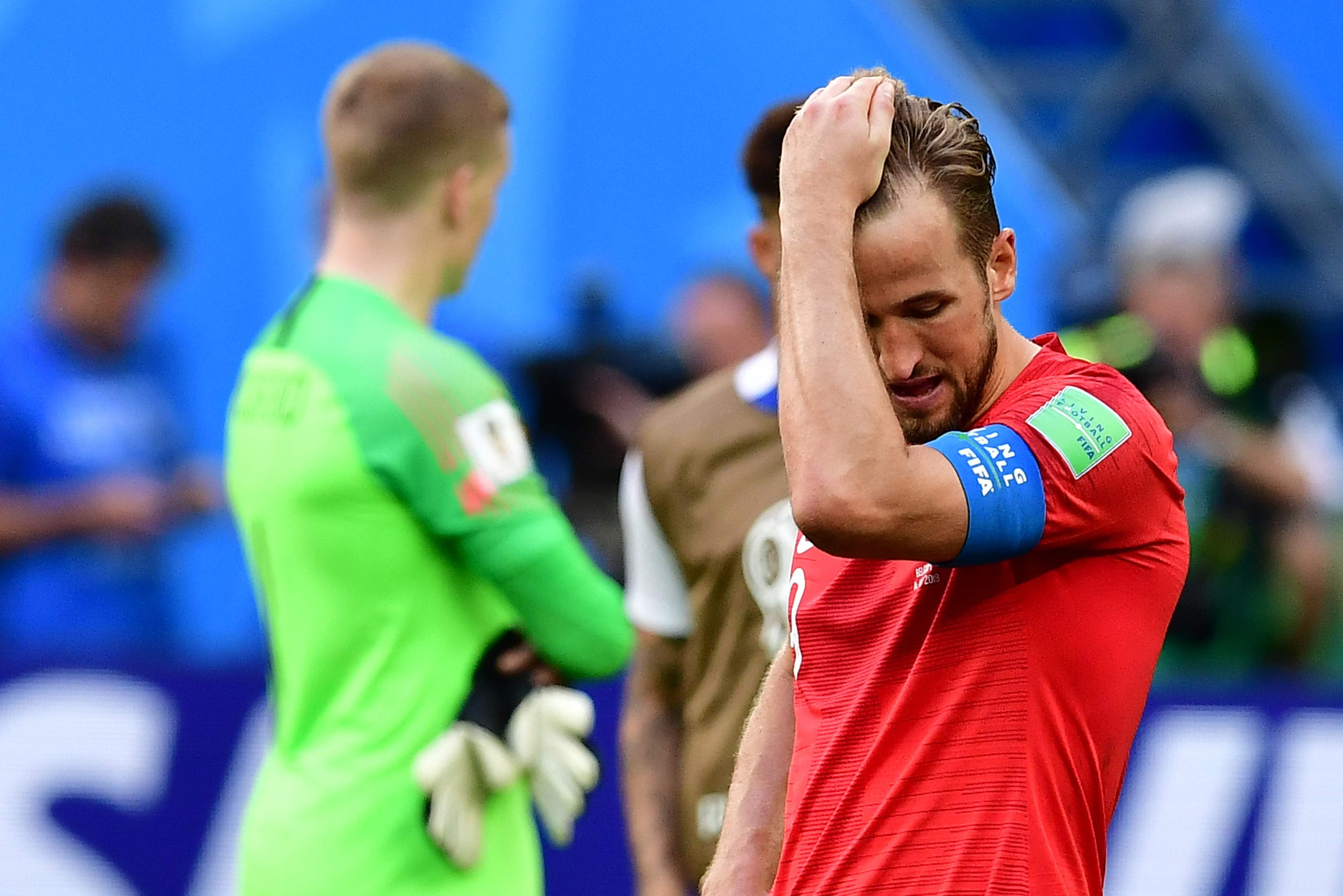 38fec4a6769 England s forward Harry Kane reacts to Belgium s victory at the end of the  their Russia 2018
