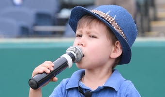 Landon Mak sings the Star-Spangled Banner before a York Revolution game at PeoplesBank Park in York, Pa. He learned to sing from a YouTube video of NHL playoffs.