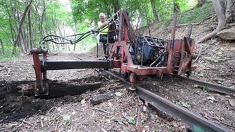 The tiny Stewartstown Railroad has some big machines to help with  the backbreaking work of railroad tie replacement.