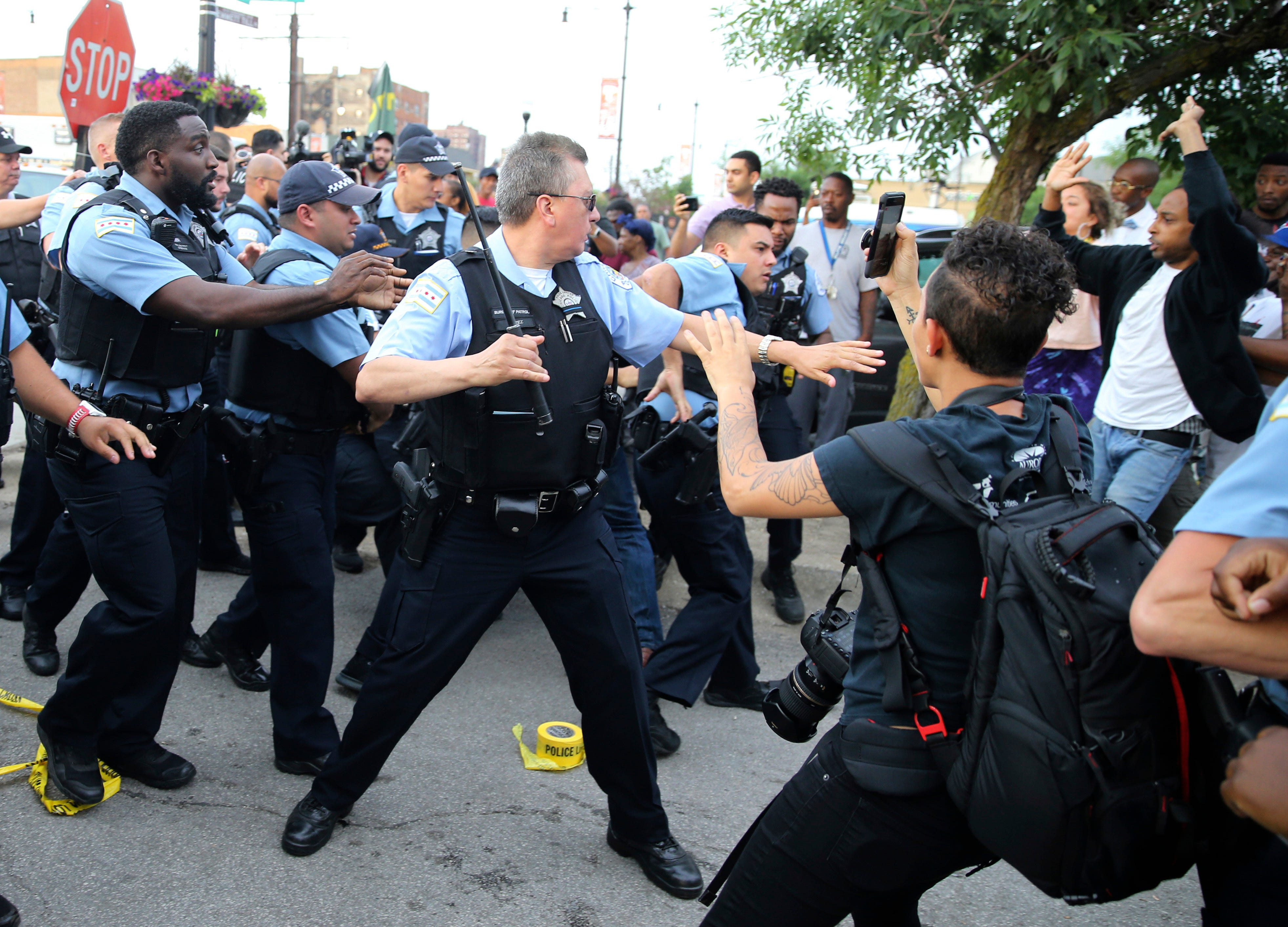Cops and protesters scuffle after man fatally shot by Chicago police officer