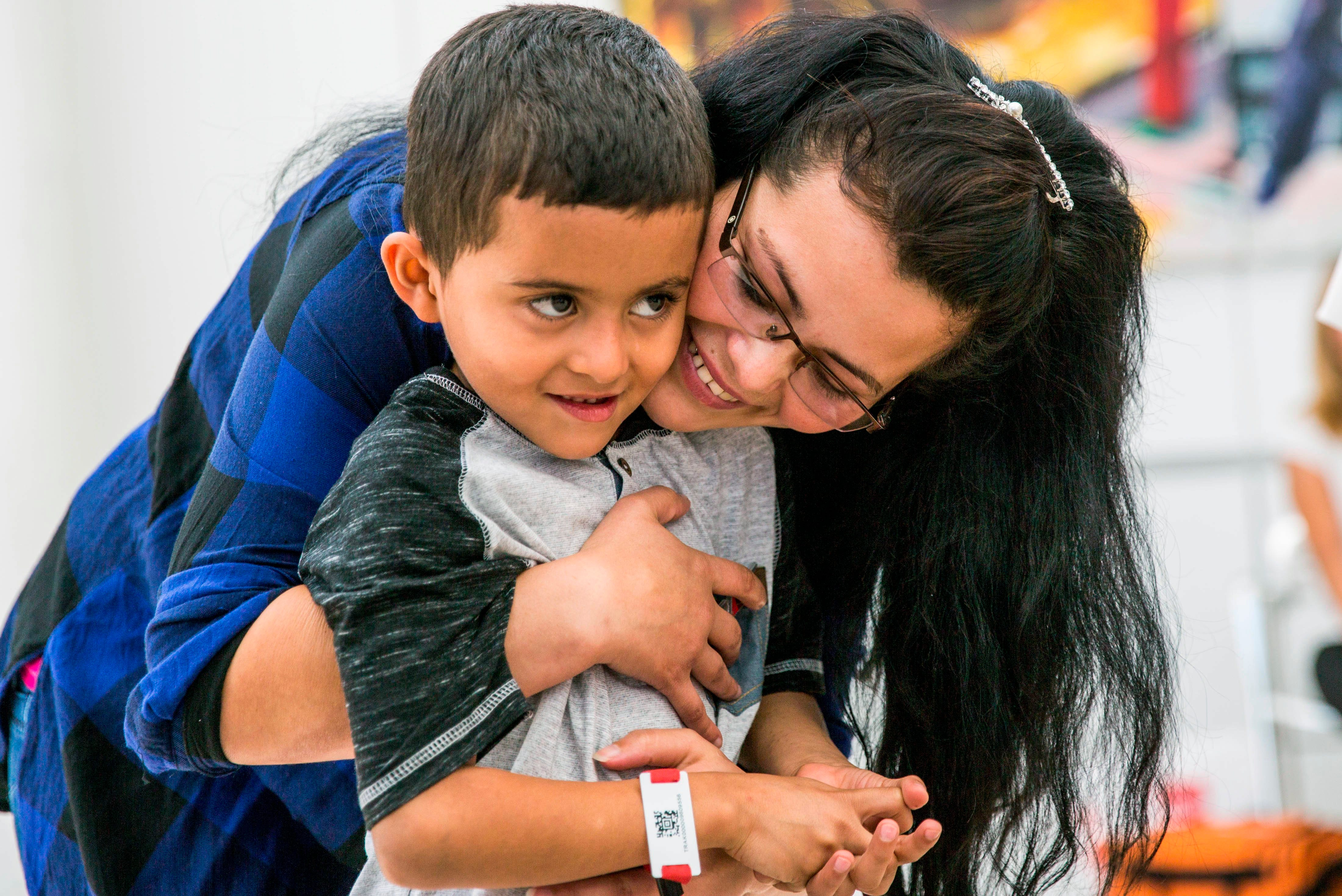 Shackles, skimpy meals and late-night bus rides: Journey of a migrant mother newly reunited with her son