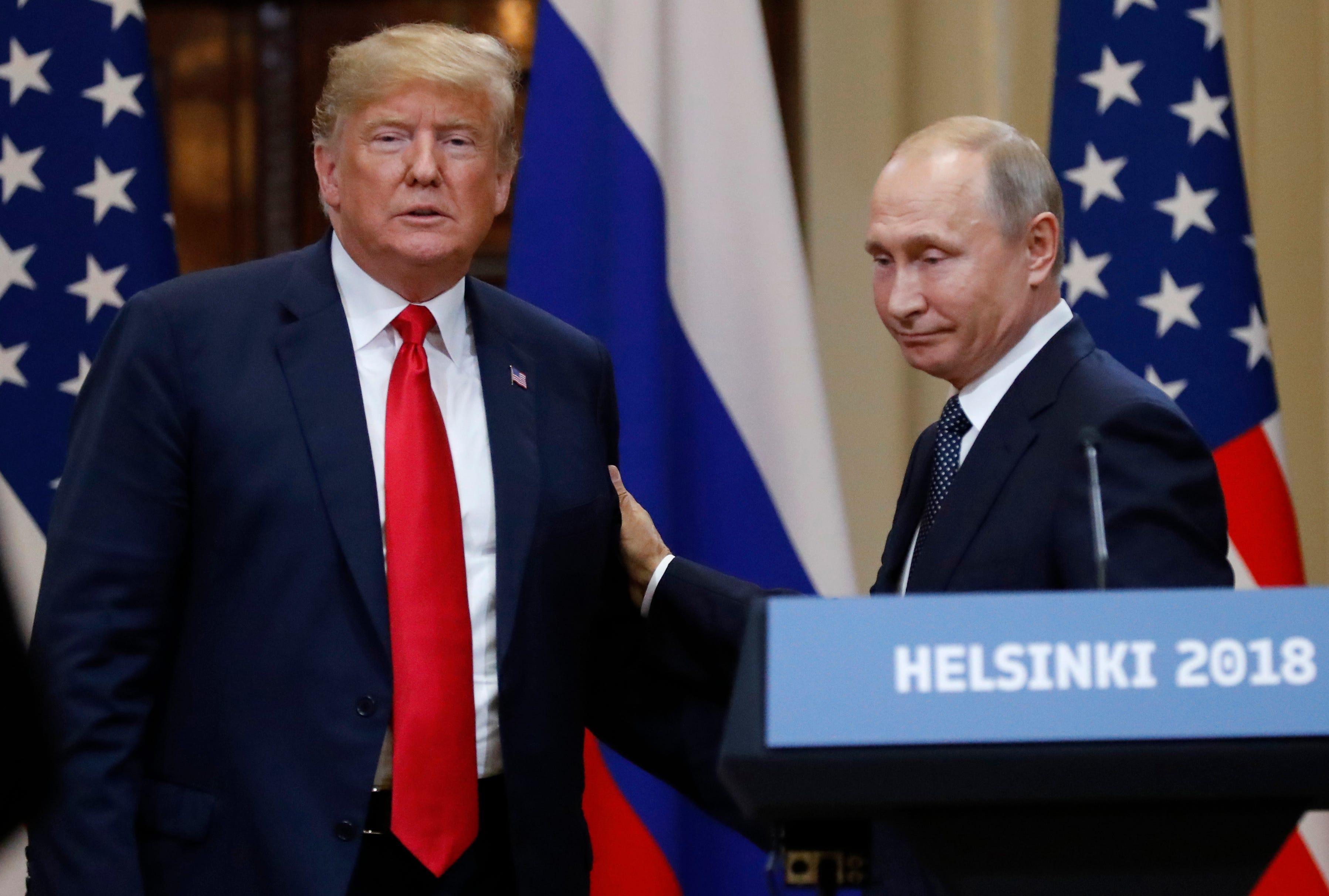 President Trump struggles to contain firestorm over Putin summit