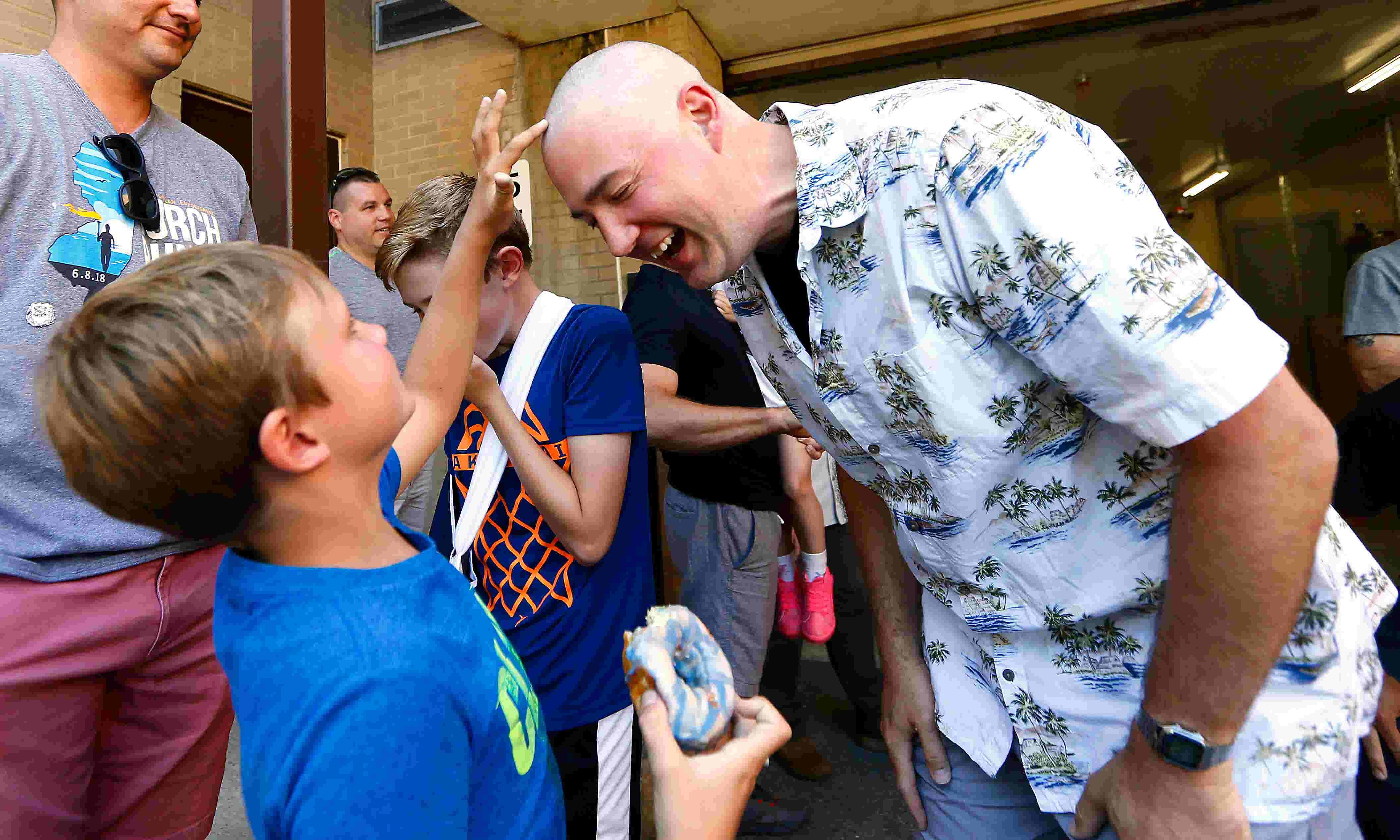 Randolph cops shave for cancer-stricken officer