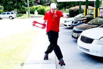 Carhop James Moffet shows off his skate moves at Sonic at 3307 N. Broadway in Knoxville, Thursday, July 19, 2018. Moffet, 29, is one of five skating carhops to participate in the national  Sonic Skate-Off next month.