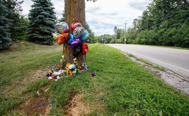Stuffed animals, balloons and other items create a roadside memorial for three-year-old Nathaniel Medina at Rocky Point Road and Prospect Avenue in Pewaukee as seen on Thursday, July 19, 2018.