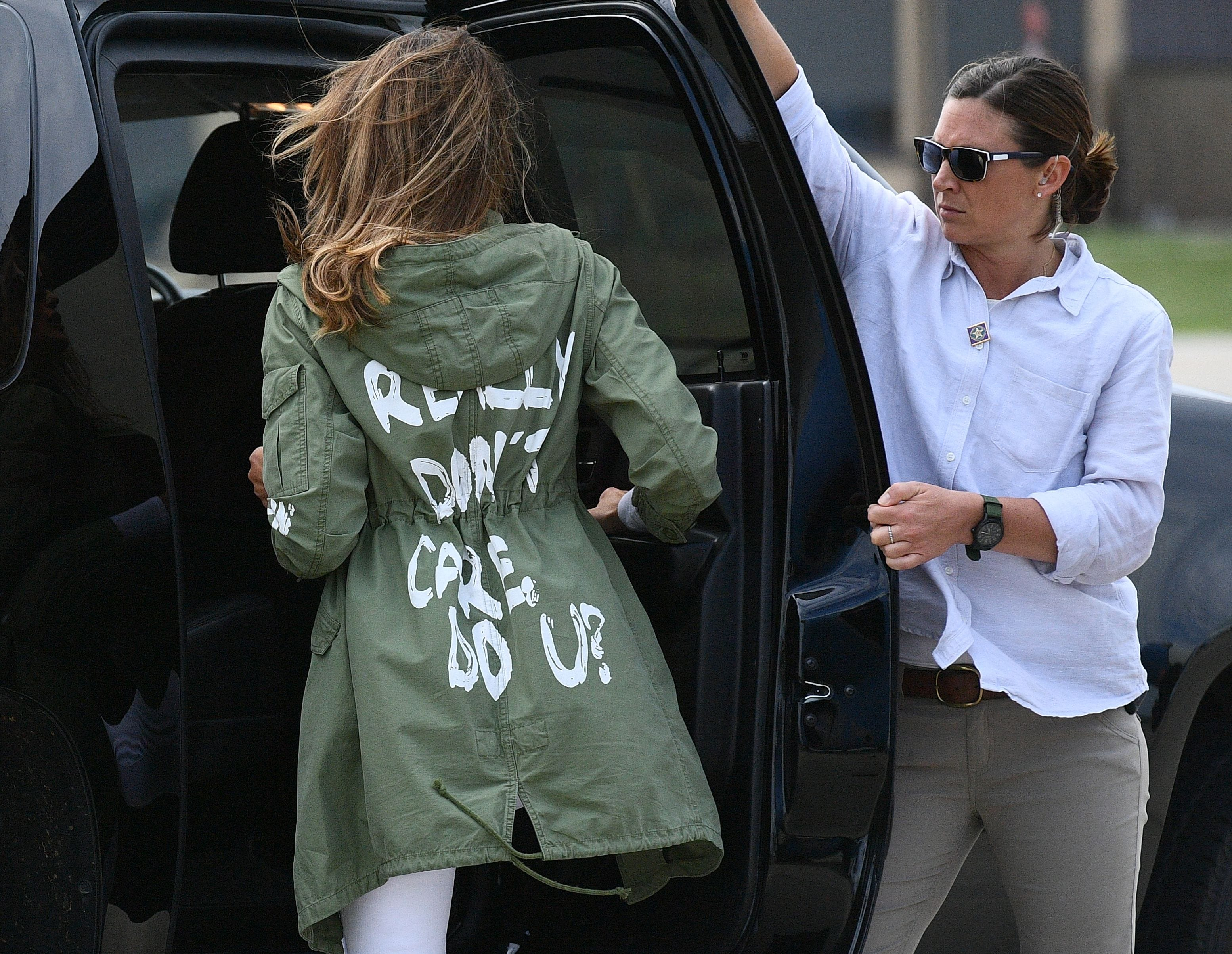 """First Lady Melania Trump departs Andrews Air Force Base in Maryland June 21, 2018 wearing a jacket emblazoned with the words """"I really don't care, do you?"""" following her surprise visit with child migrants on the US-Mexico border."""