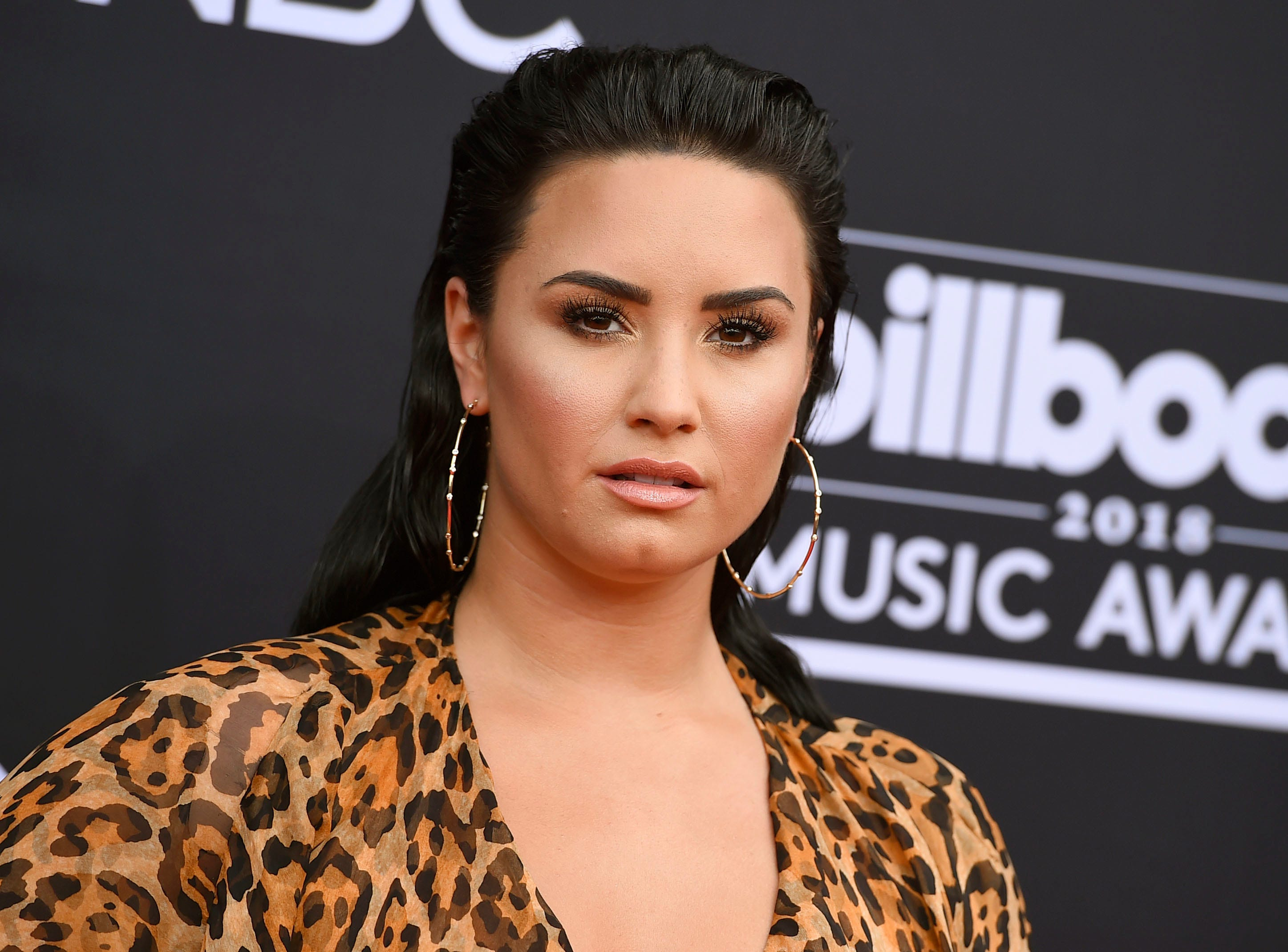 Rep: Demi Lovato is 'awake and with her family' after possible overdose