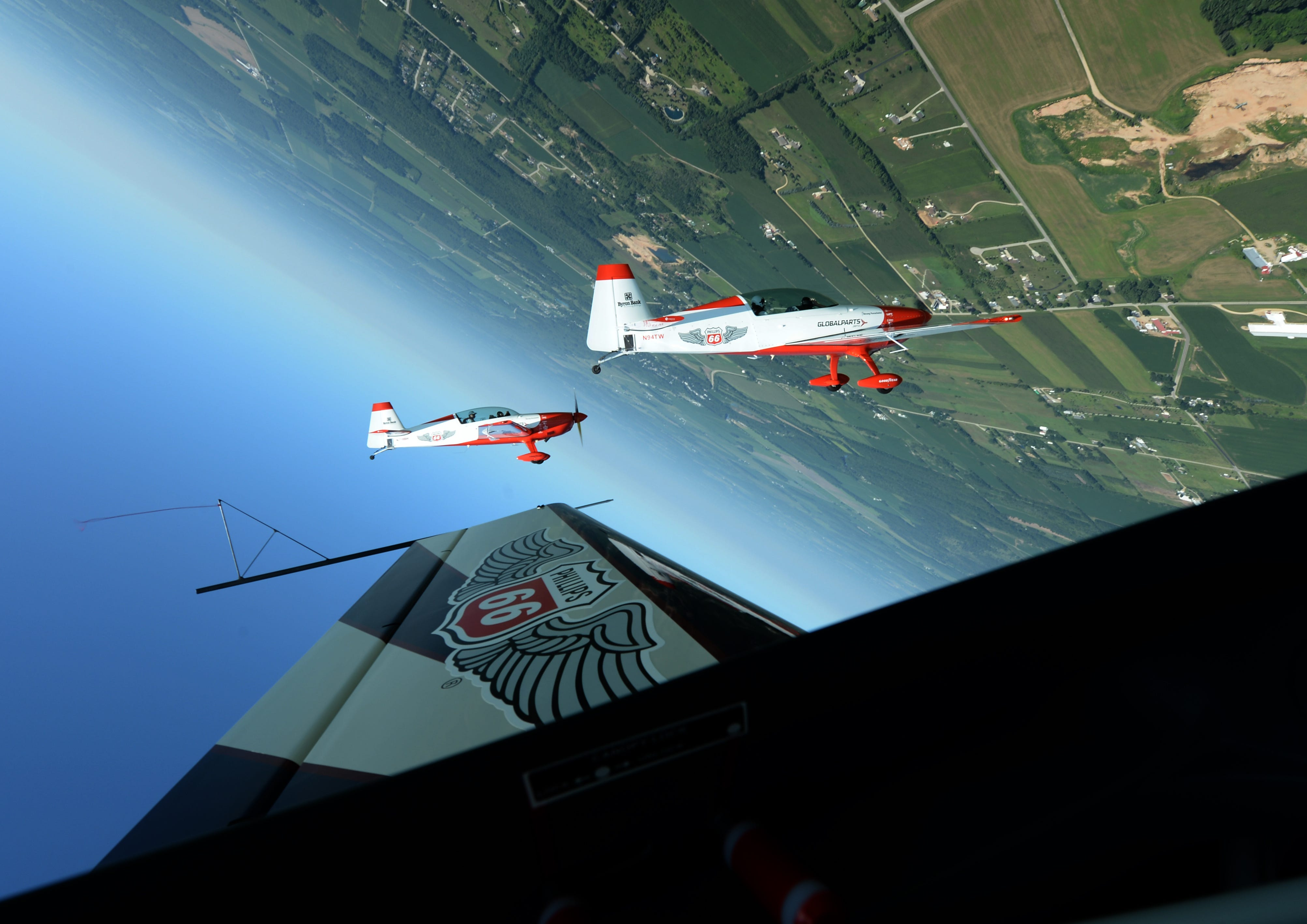 7/24/2018 Oshkosh Wisconsin, Airventure.     The Phillips 66 Aerostars come over the top of a loop while flying near Oshkosh Wisc. in their Extra 300L airplanes. The aerobatic team was in the area attending the Airventure airshow which runs through 7/2