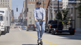 """The Enquirer's intern, Sam, test drives the new public """"Bird"""" scooters downtown."""