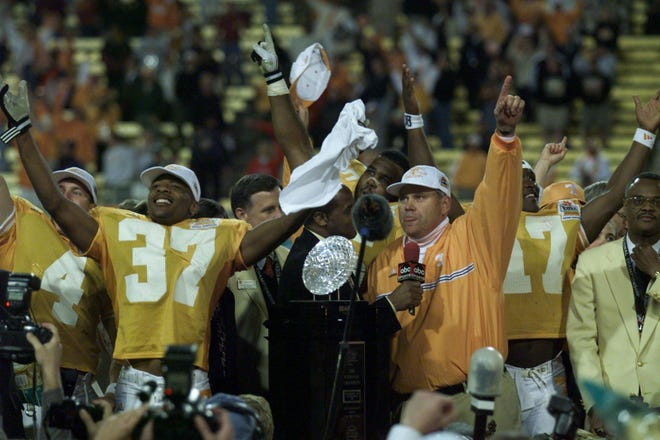 Tennessee receiver Peerless Price and coach Phillip Fulmer celebrate the national championship after defeating Florida State in the Fiesta Bowl on Jan. 4, 1999.