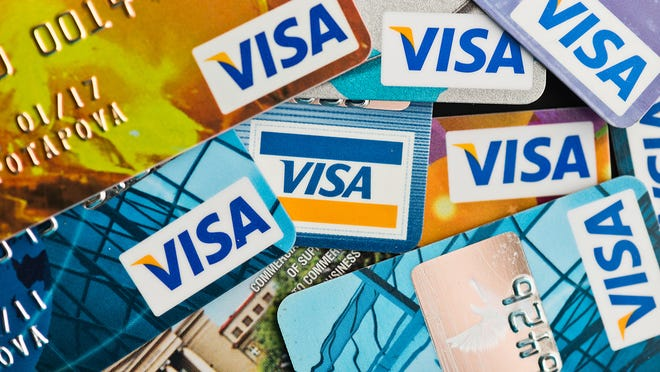 Banks increasingly are rewarding customers who hold onto their credit cards, even if they aren't using them.