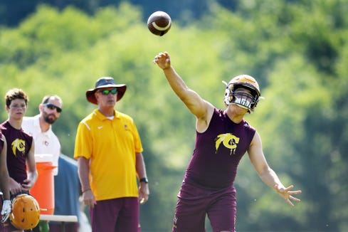 Cherokee junior Bobby Crowe passes the ball in the WNC FCA 7 on 7 competition at Erwin High July 10, 2018.