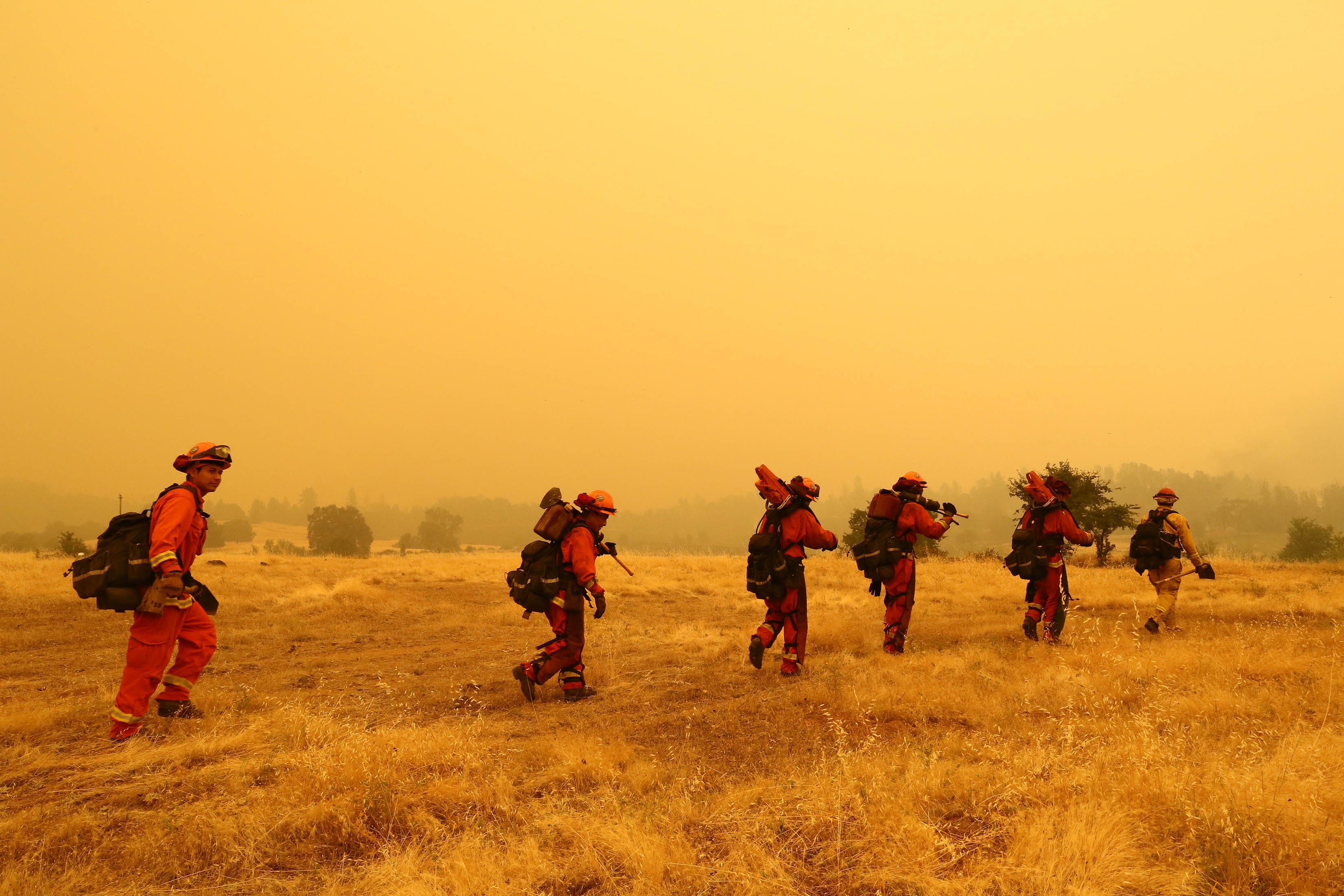 Inmate firefighters head out to the field to prepare containment areas in Igo, Calif. on July 28, 2018.