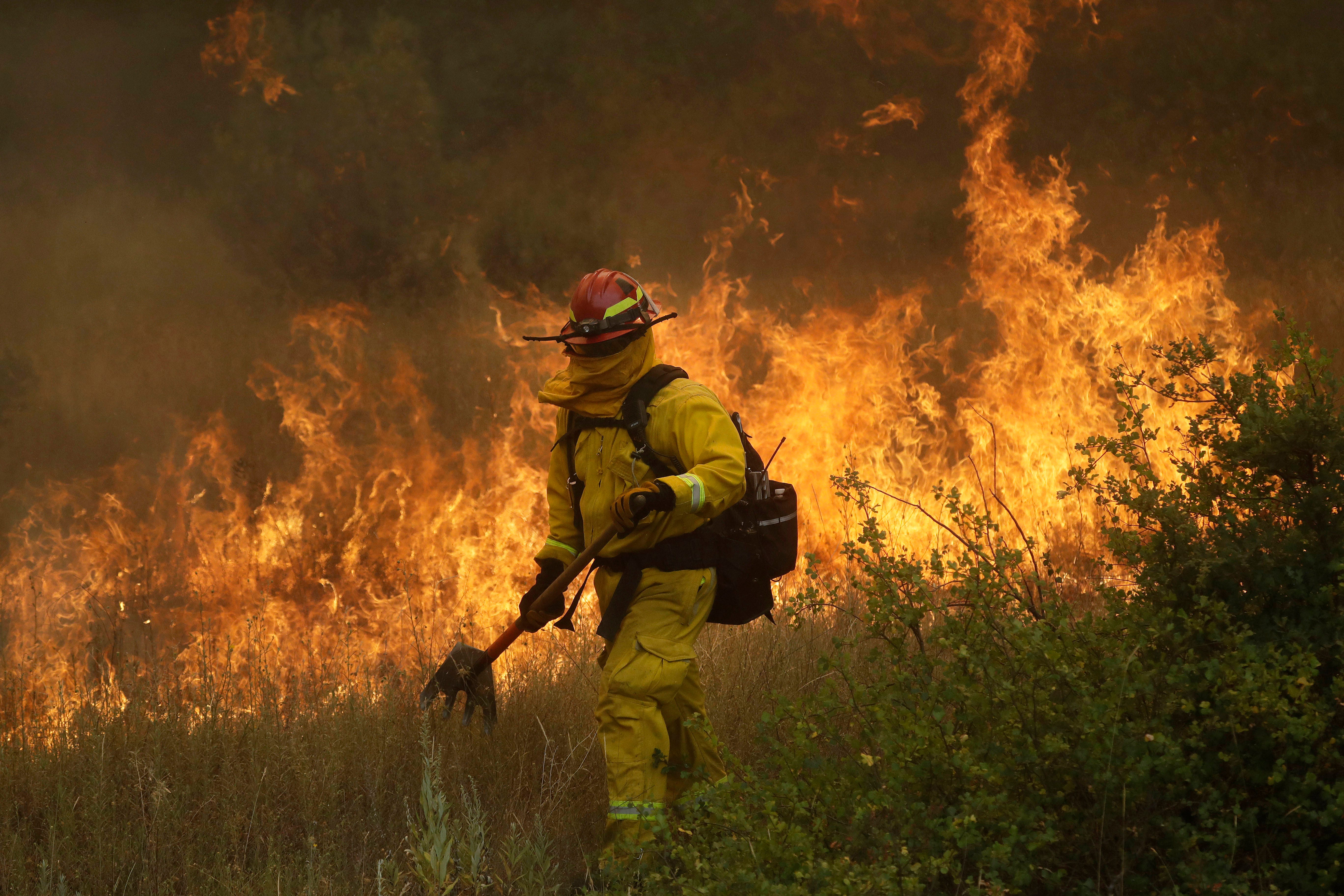 California's largest wildfire tops 300,000 acres; containment remains at 47 percent
