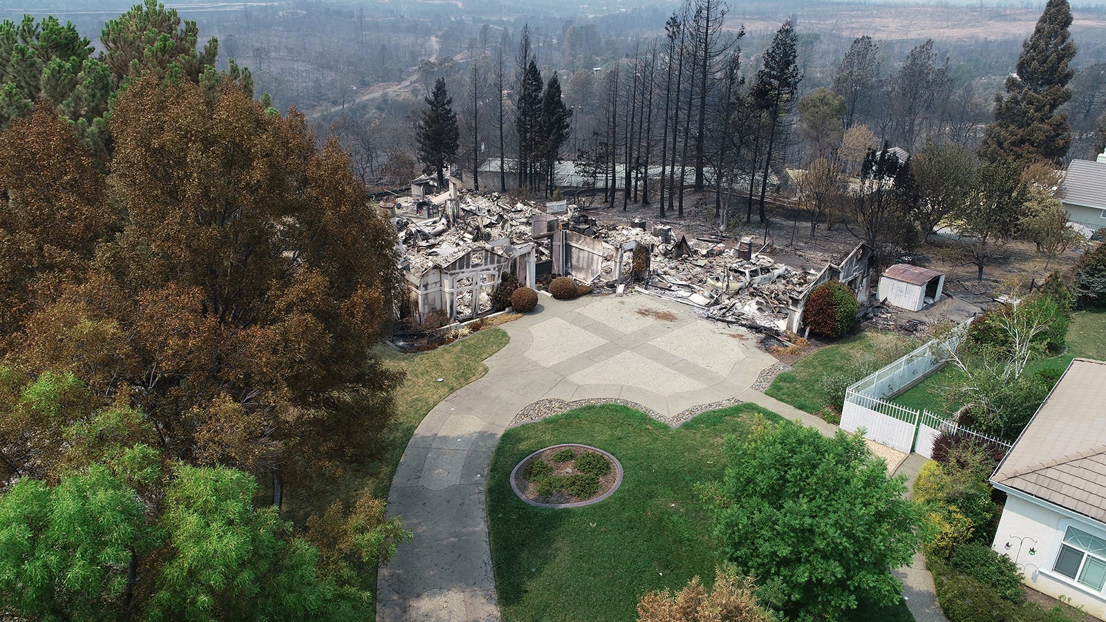 Homes in the River Ridge Park subdivision show the damage from the Carr Fire Wednesday August 1, 2018 in Redding, CA. This home at 3474 Showboat Ct. is completely destroyed.