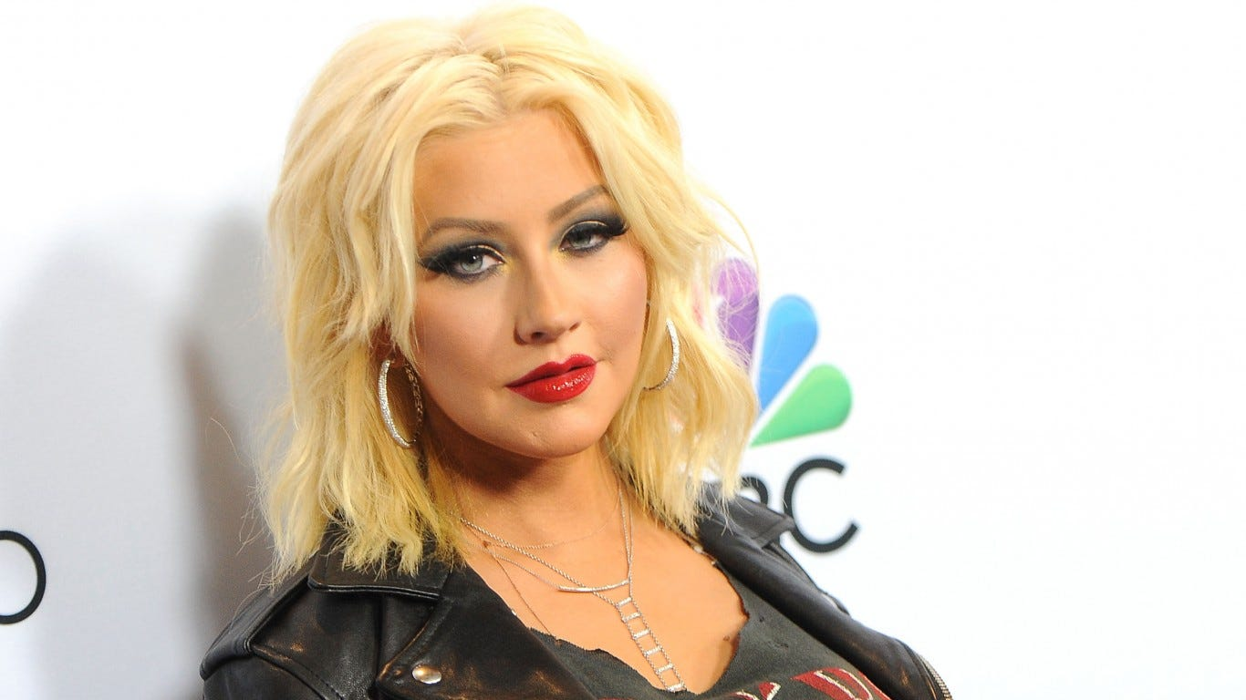Christina Aguilera says she didn't punch Pink, but did try to kiss her
