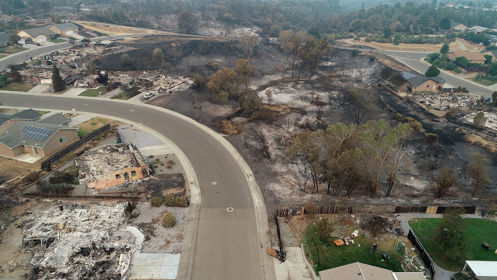 A view of the Lake Keswick Estates neighborhood on the northwest side of Redding, CA. This view Cape Cod Drive looking southwest shows the devastation from the Carr Fire as it moved through the area.