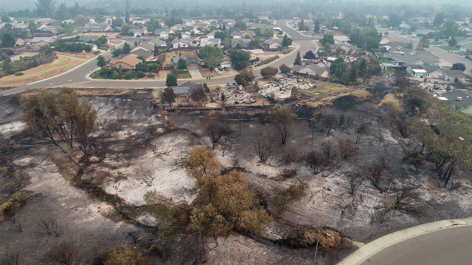 A view of the Lake Keswick Estates neighborhood on the northwest side of Redding, CA. This view of Balboa Drive looking northwest shows the devastation from the Carr Fire as it moved through the area.