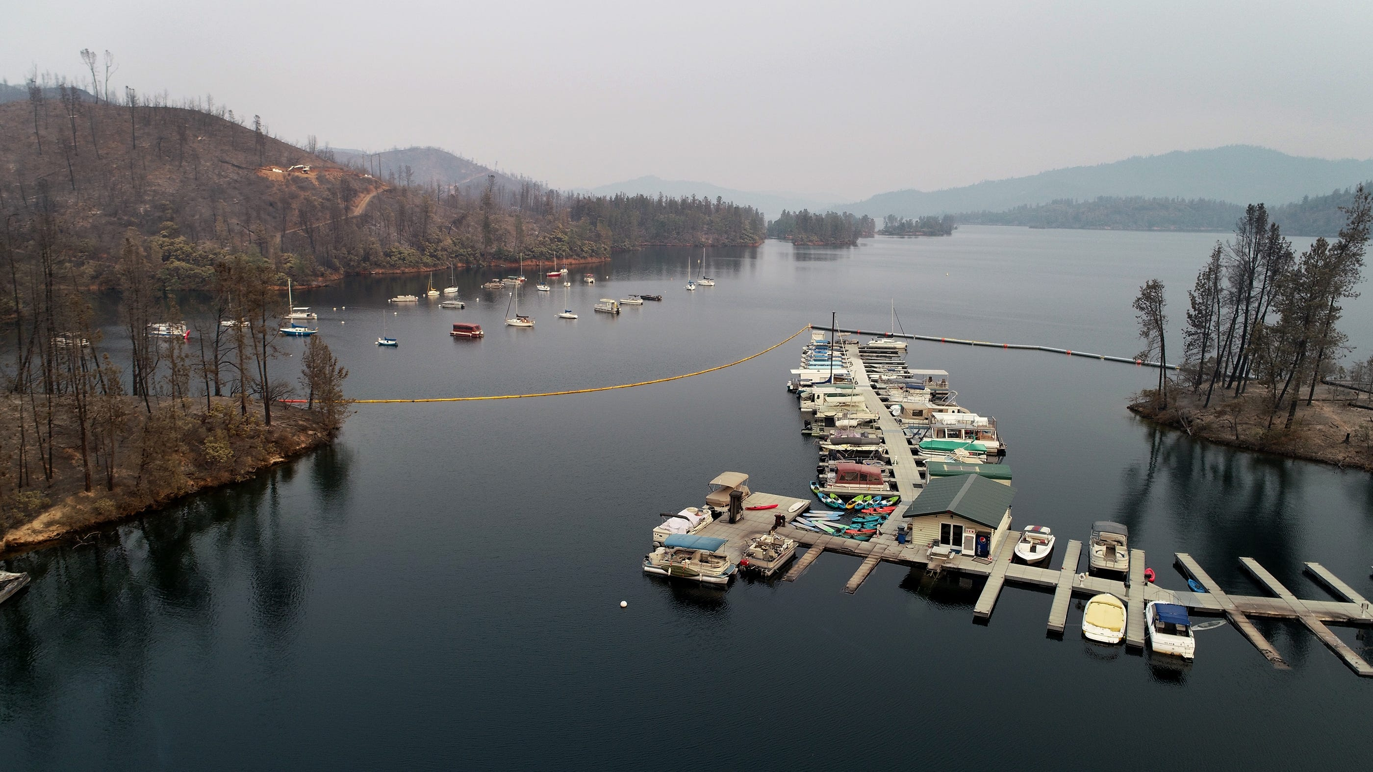 Damage from the Carr Fire is seen at Oak Bottom Marina in Whiskeytown, Calif. Aug. 1, 2018. Several boats were affected by the fire when it rolled through the area late last week.