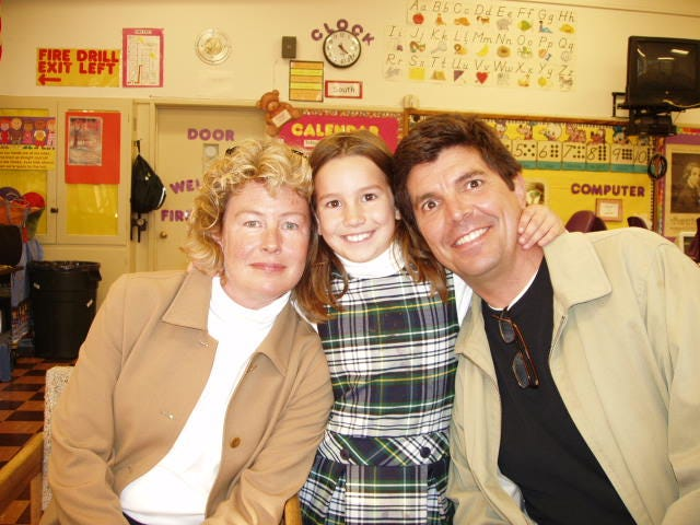Mollie Tibbetts can be seen with her mother, Laura Calderwood, and her father, Rob Tibbetts, during a conference with her teacher at Corpus Christi School in Piedmont, California.