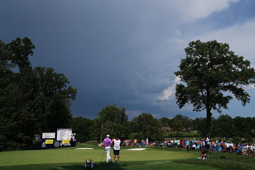 Heavy rains halt second-round play, could help golfers on Saturday