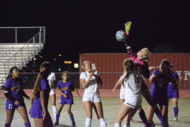 Kirtland Central's Jayden Guillory (13) knocks down the ball with her right arm for a save off a corner kick during a match on Tuesday, Oct. 10, 2017 at Farmington. Guillory will continue her soccer career at NCAA Division II Adams State University in Alamosa, Colorado.