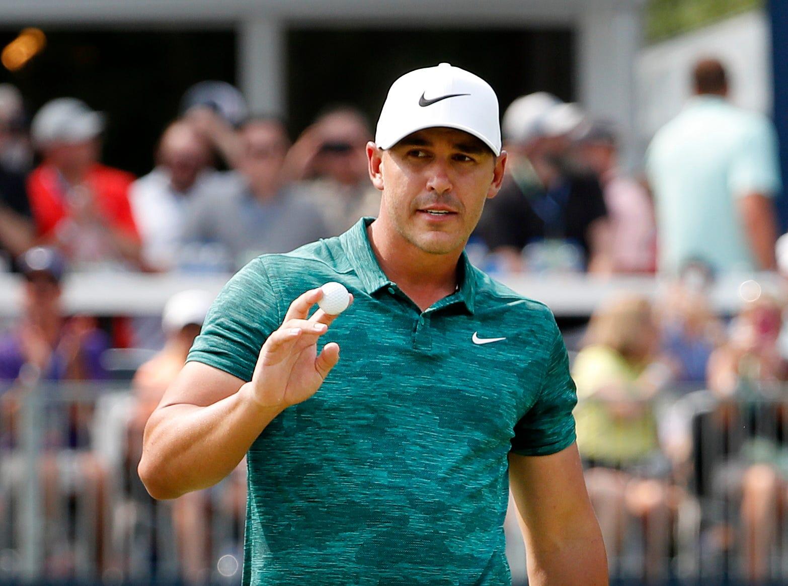 Brooks Koepka holds off Tiger Woods, Adam Scott to win PGA Championship