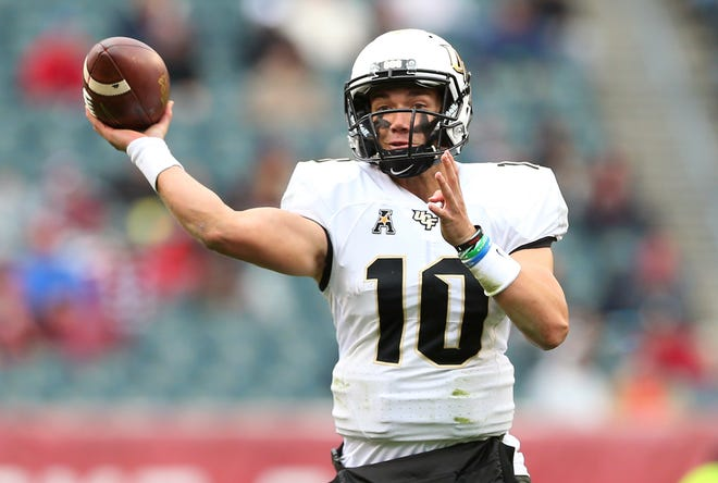FILE - In this Nov. 18, 2017, file photo, UCF quarterback McKenzie Milton (10) attempts a pass against Temple during the first quarter in an NCAA college football game in Philadelphia. Milton was eighth in the Heisman voting last year after he led the Knights to an improbable 13-0 record and a victory over Alabama in the Peach Bowl. (AP Photo/Rich Schultz, File)