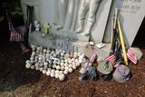 Tributes left for Babe Ruth at Gate of Heaven Cemetery, on the 70th anniversary of his death.