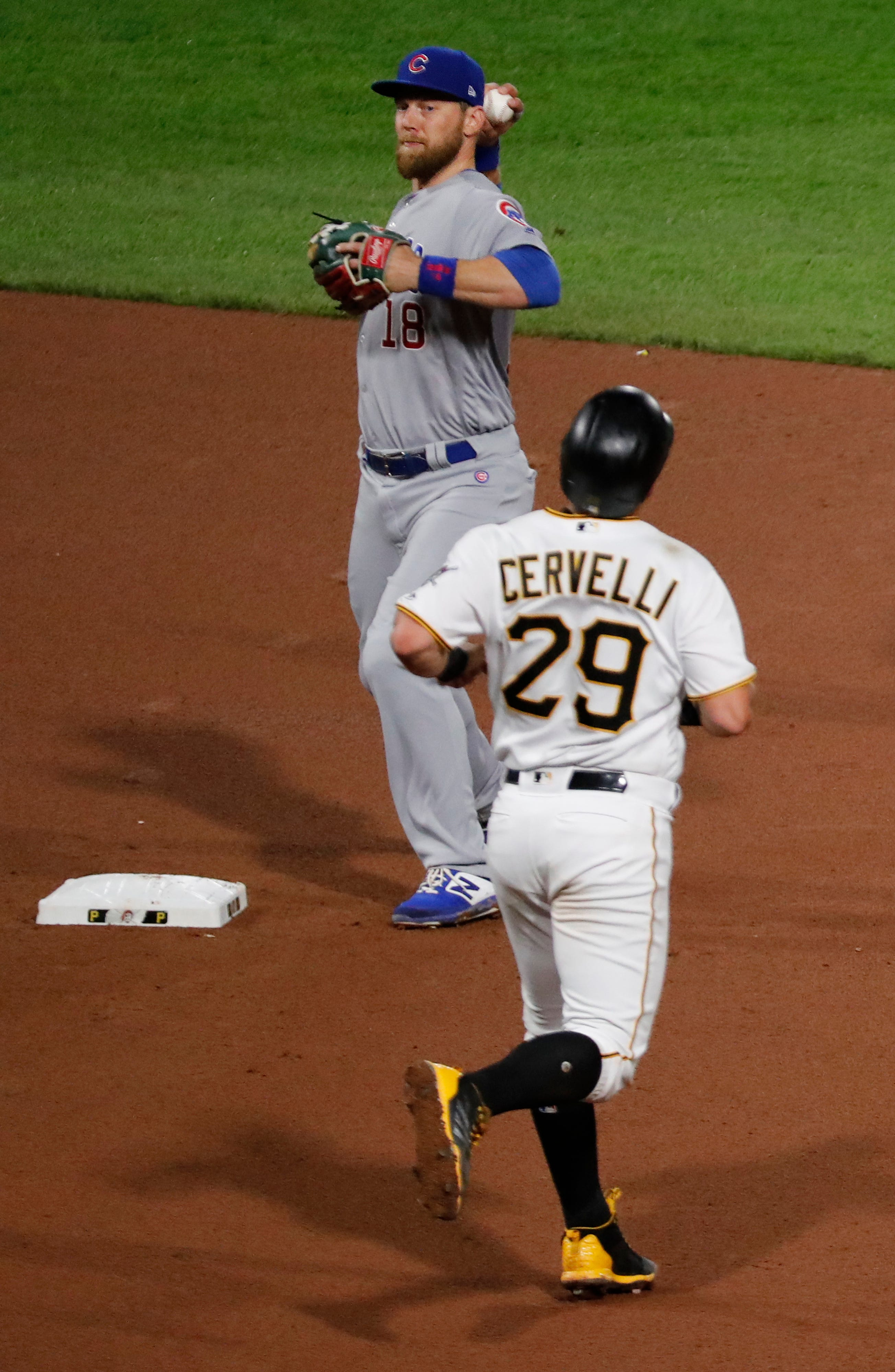 Cubs turn record-tying 7 double plays, beat Pirates 1-0