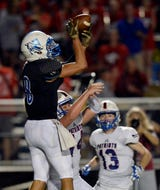 Nolensville junior Tim Coutras catches one of four TD passes against Nolensville.
