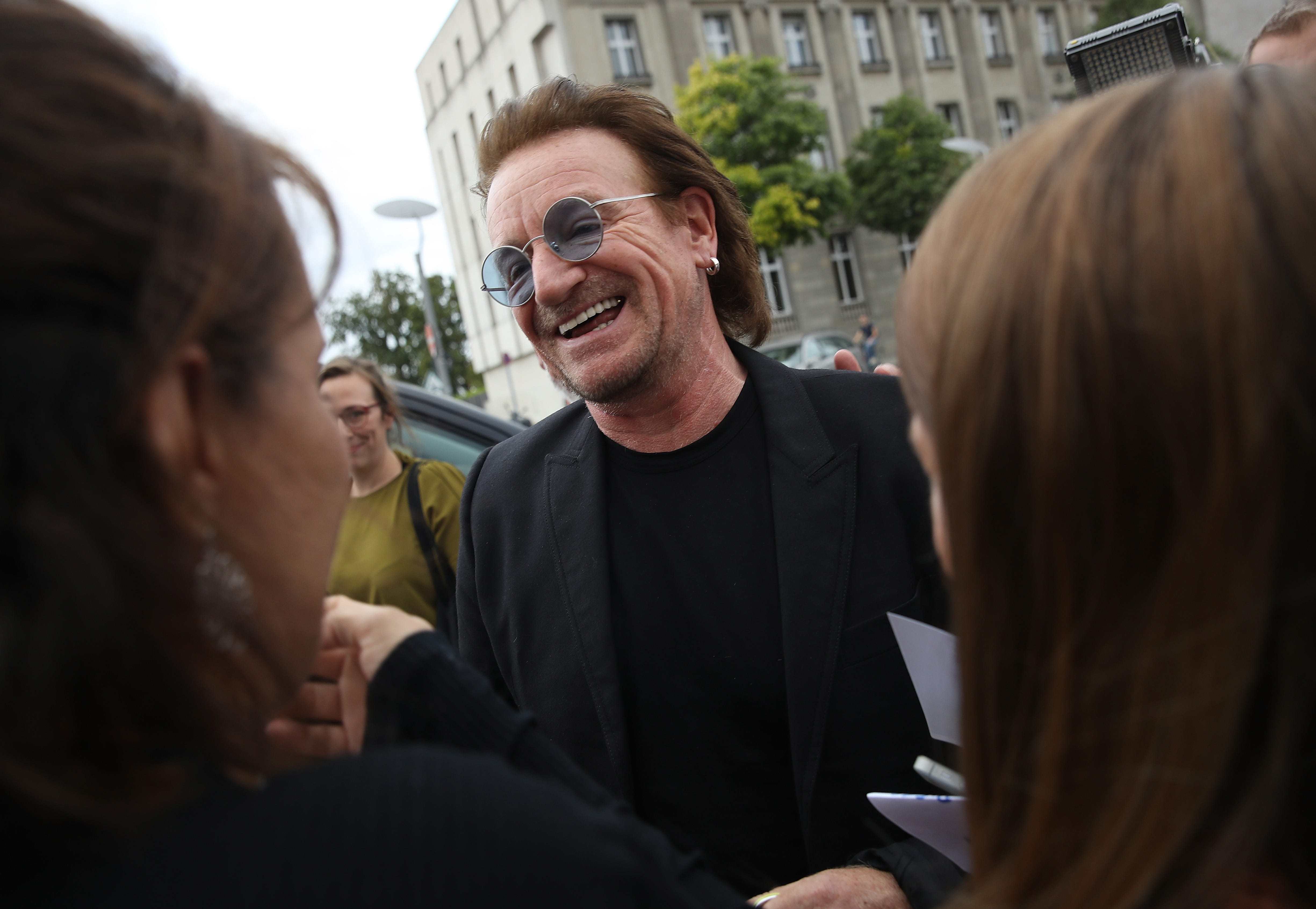 U2 ends Berlin concert early after Bono loses voice