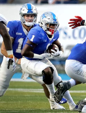 MTSU quarterback Brent Stockstill (12) hands the ball off to Terell West (1) during a game against UT Martin on Saturday.