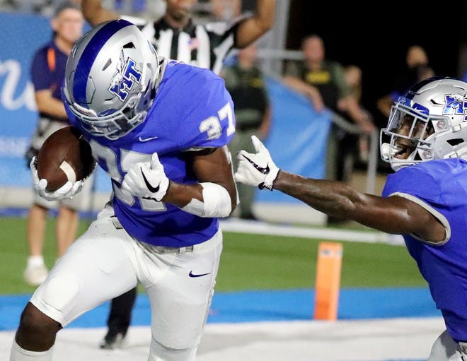 MTSU's Patrick Smith (37) and MTSU's Ty Lee (8) celebrate Smith's touchdown against UT Martin during the game at MTSU on Saturday, Sept. 8, 2018.