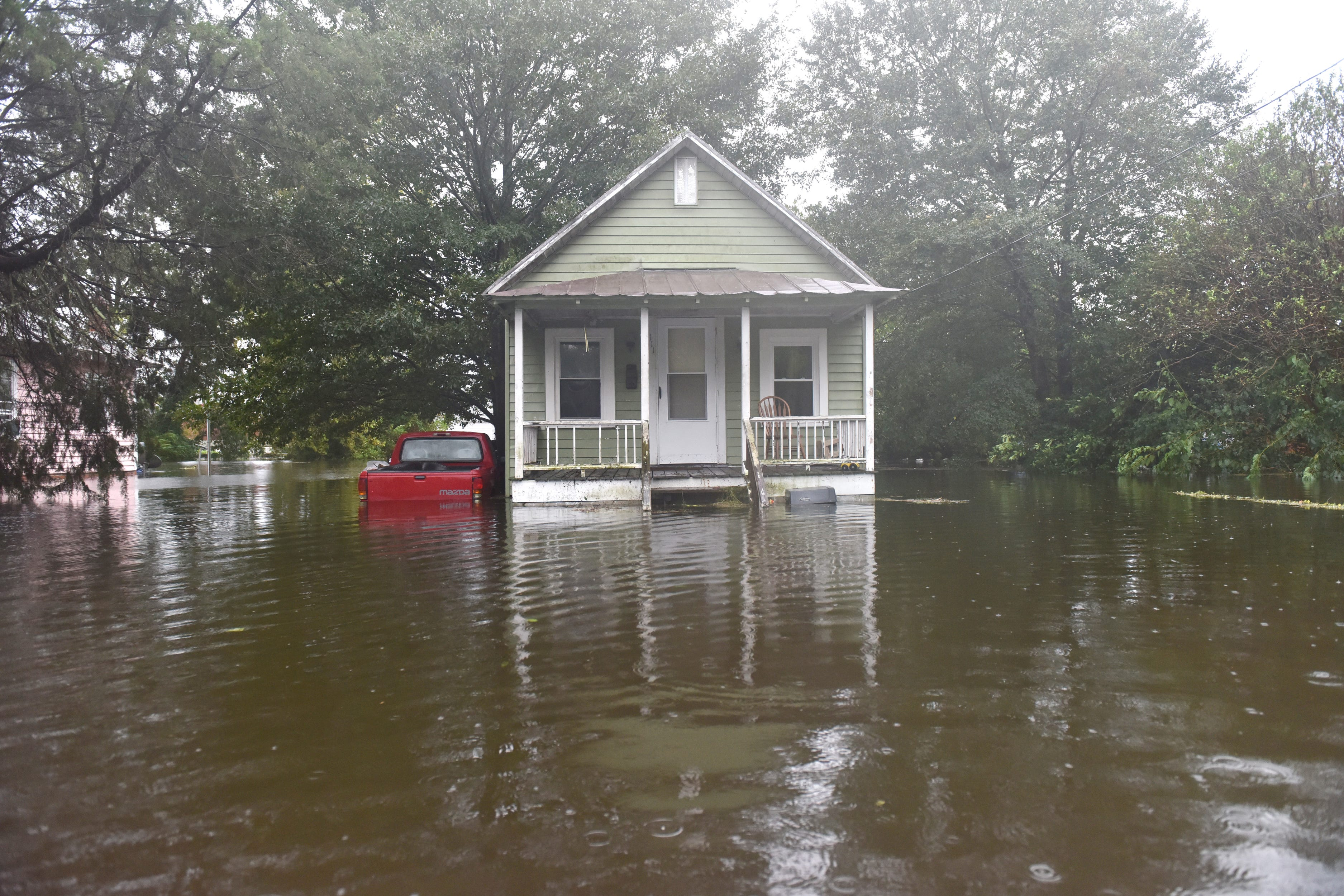 A home sits in high water on W 6th St after Hurricane Florence brought heavy rains to Washington, N.C. on Friday afternoon on September 14, 2018.  (Via OlyDrop)