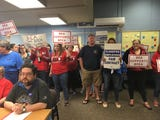 More than 100 people demonstrated at the Bremerton school board meeting Sept. 20, 2018, calling for higher wages for non-teaching staff.