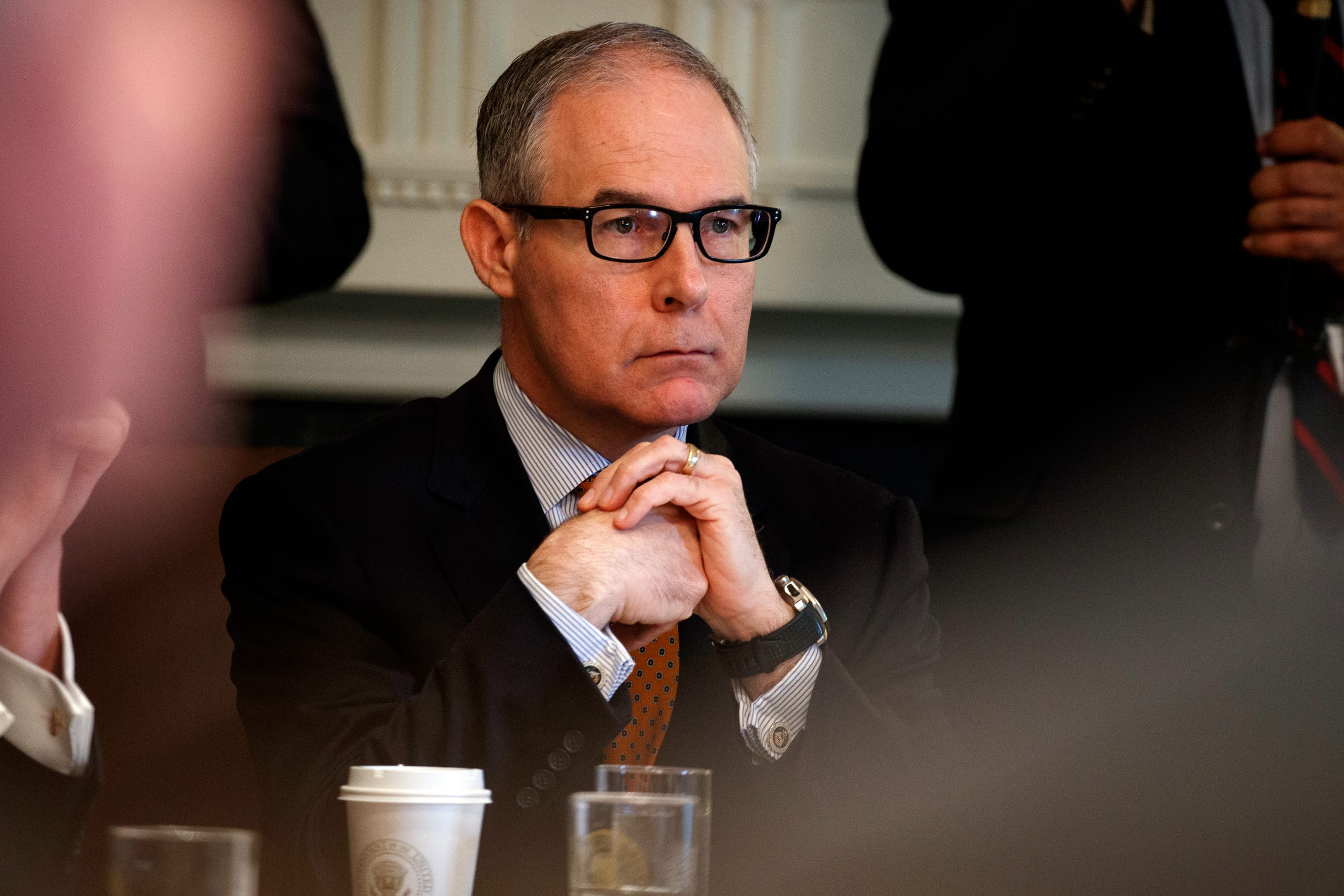 Environmental Protection Agency administrator Scott Pruitt listens as President Trump speaks during a cabinet meeting at the White House in Washington on June 21, 2018. Pruitt, a former Oklahoma state senator and two-term Republican attorney general, resigned suddenly July 5, 2018 amid ethics investigations, including ones examining his lavish spending on first-class airline seats and a $43,000 soundproof booth for making private phone calls.