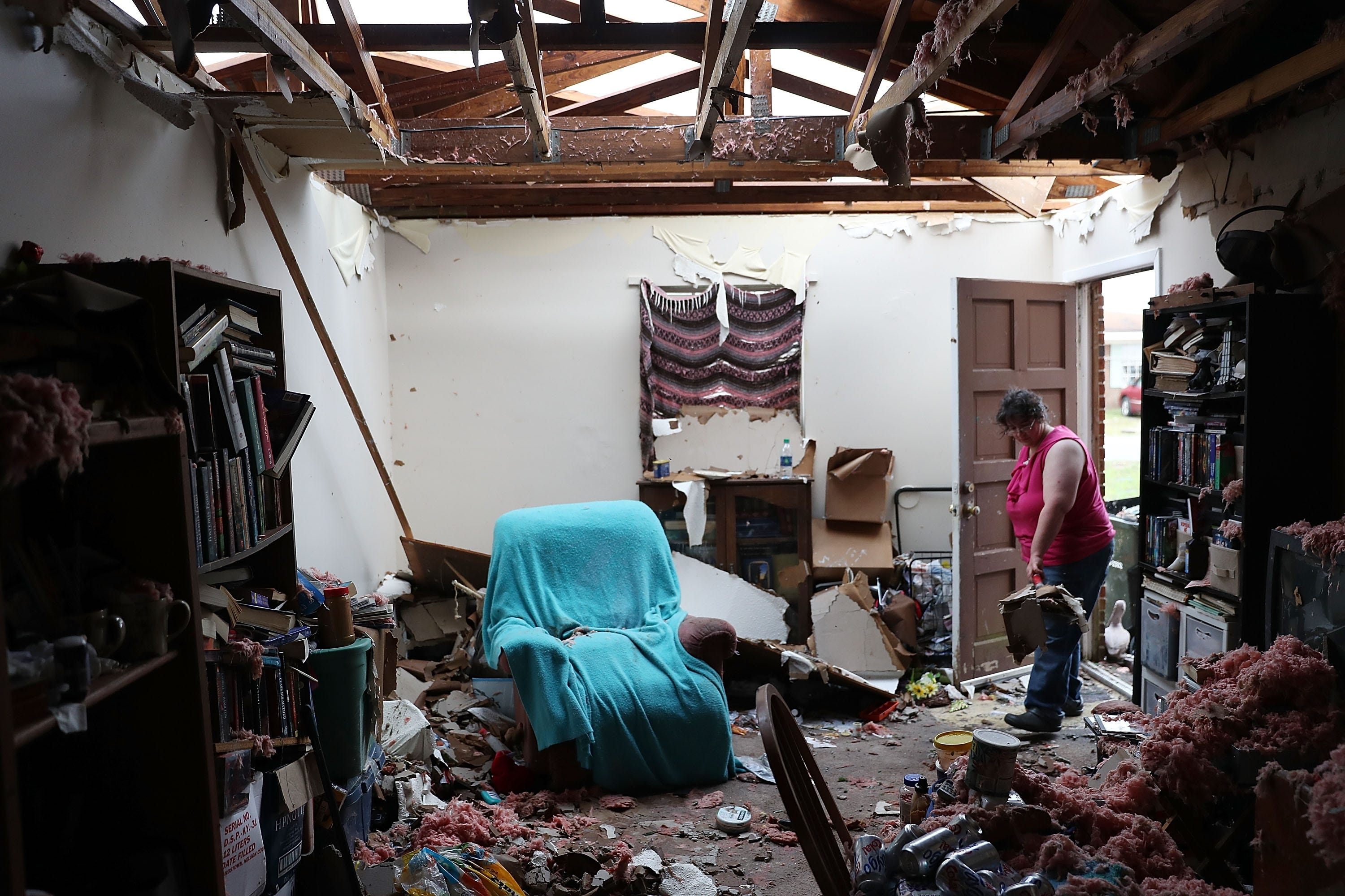 PANAMA CITY, FL - OCTOBER 11:  Amanda Logsdon begins the process of trying to clean up her home after the roof was blown off by the passing winds of hurricane Michael on October 11, 2018 in Panama City, Florida. The hurricane hit the Florida Panhandle as a category 4 storm.  (Photo by Joe Raedle/Getty Images) ORG XMIT: 775241167 ORIG FILE ID: 1051882830