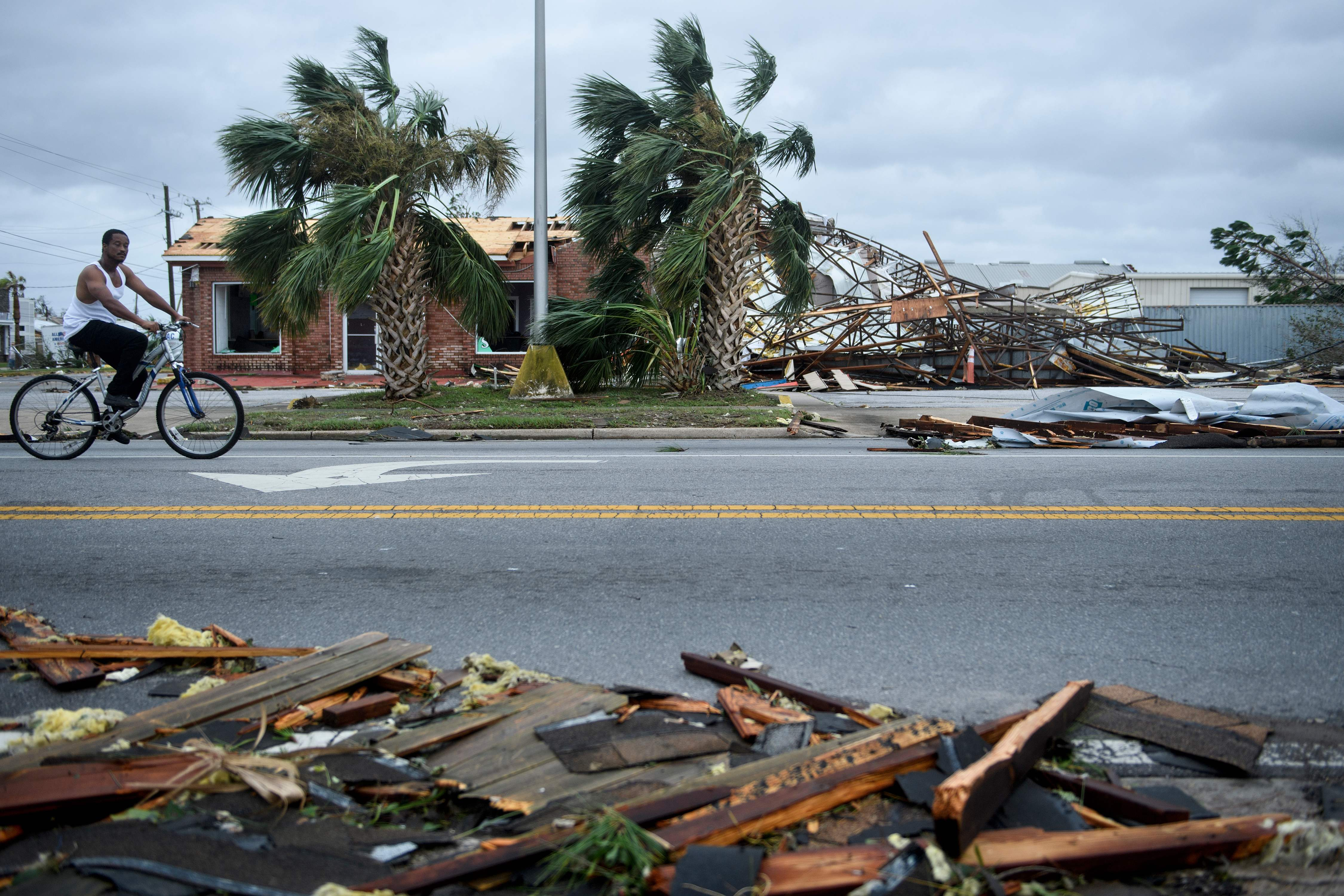 """TOPSHOT - Storm damage is seen after Hurricane Michael in Panama City, Florida on October 10, 2018. - Michael slammed into the Florida coast on October 10 as the most powerful storm to hit the southern US state in more than a century as officials warned it could wreak """"unimaginable devastation."""" Michael made landfall as a Category 4 storm near Mexico Beach, a town about 20 miles (32kms) southeast of Panama City, around 1:00 pm Eastern time (1700 GMT), the National Hurricane Center said. (Photo by Brendan Smialowski / AFP)BRENDAN SMIALOWSKI/AFP/Getty Images ORG XMIT: Hurricane ORIG FILE ID: AFP_19X5QL"""