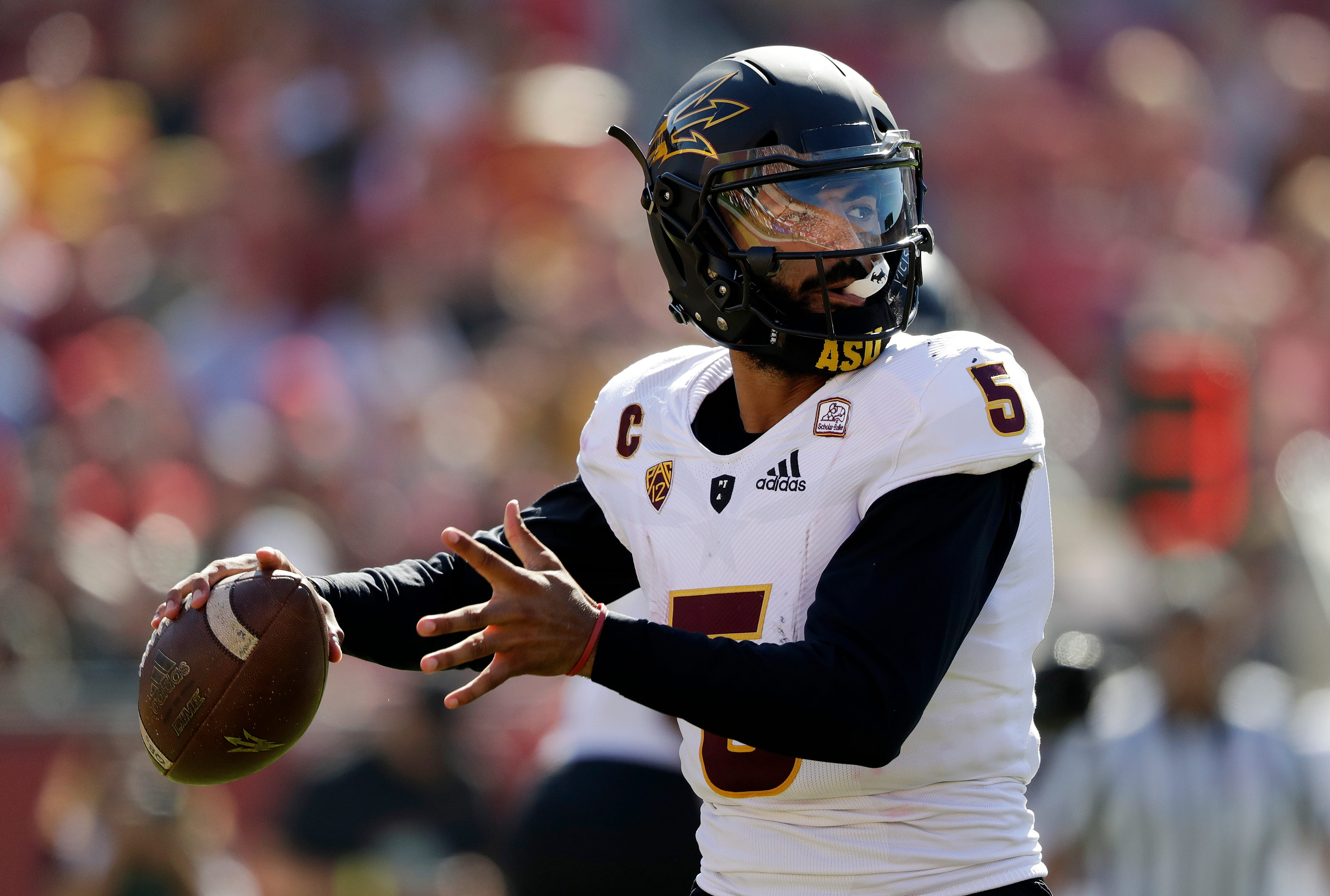 23153a0a6 LOS ANGELES (AP) — N Keal Harry scored on a 92-yard punt return and Arizona  State defeated Southern California 38-35 on Saturday.