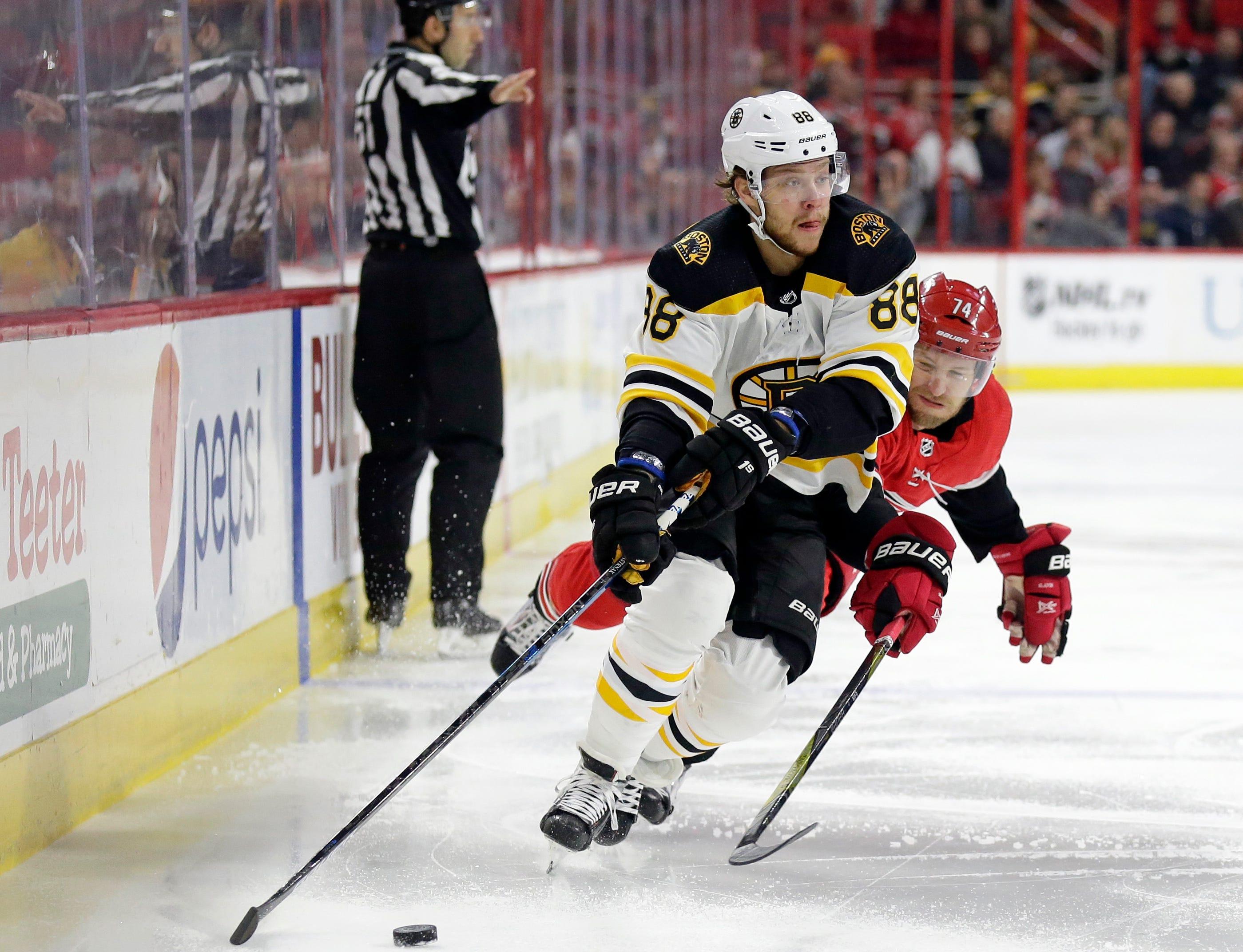 Marchand, Bruins stop Hurricanes 3-2