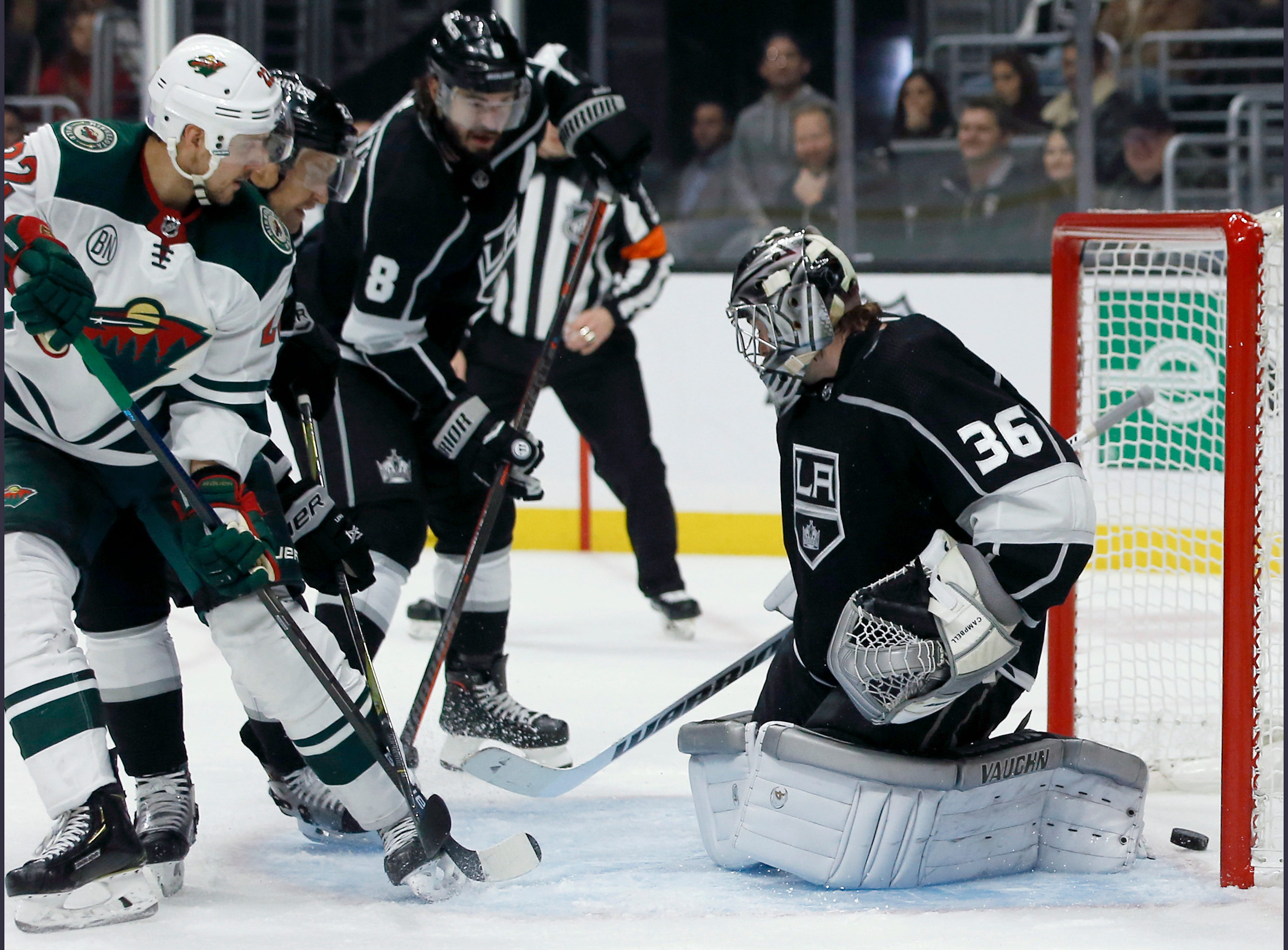 Parise reaches 700 points, Wild top Kings 3-1