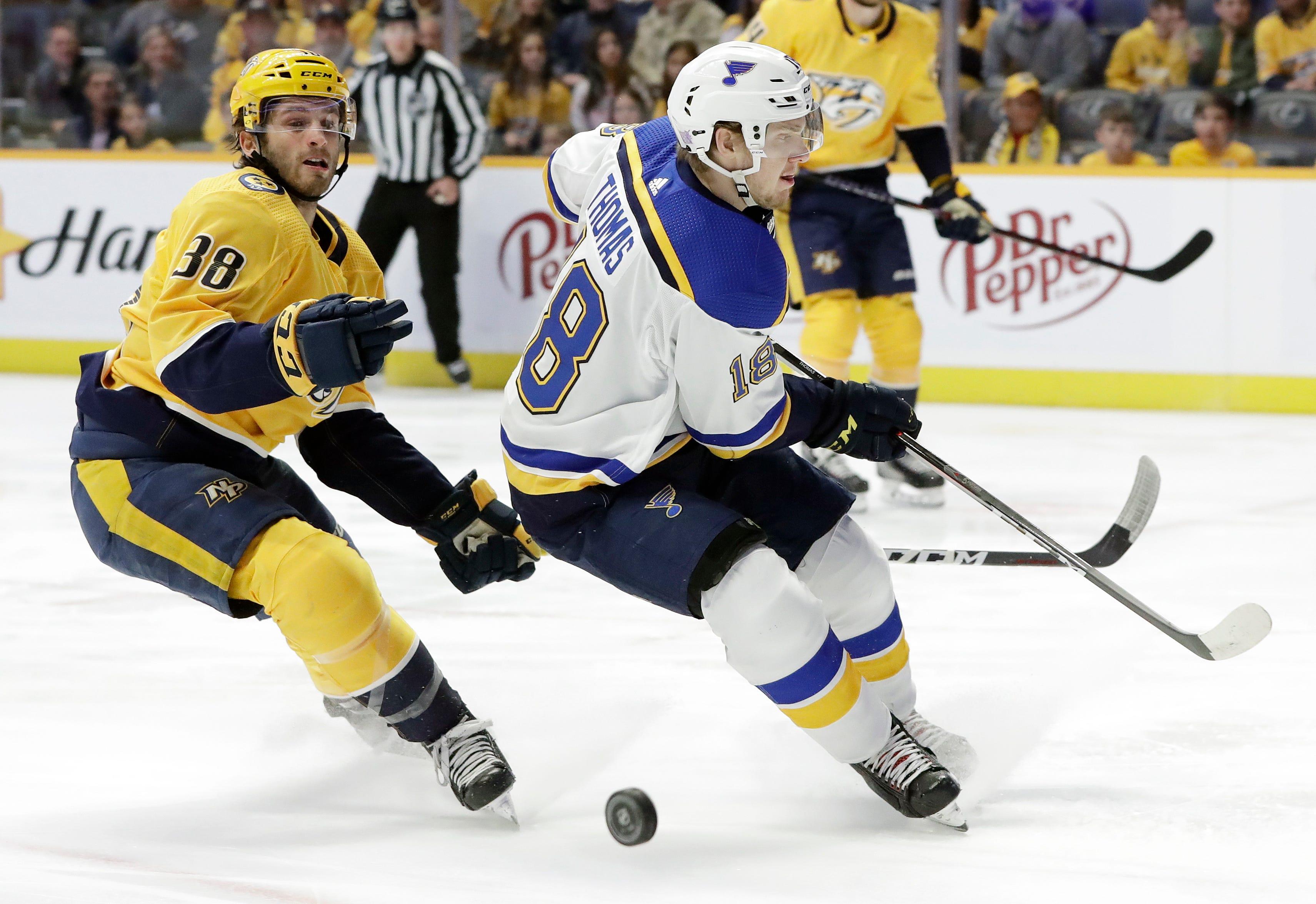 Rinne sets mark for Finnish goalies, Predators top Blues 4-1