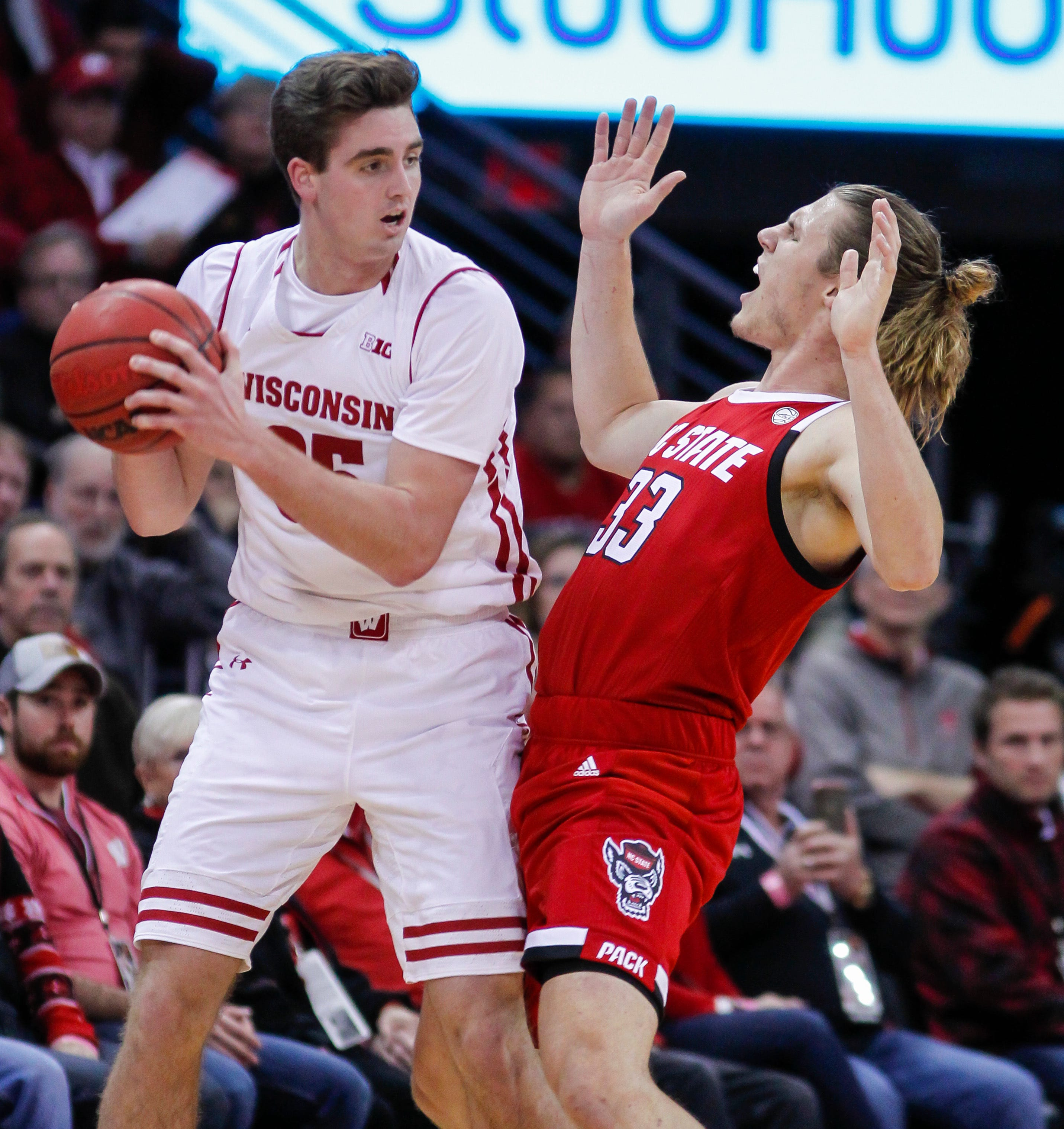 Happ helps No. 22 Badgers withstand NC State in 79-75 win