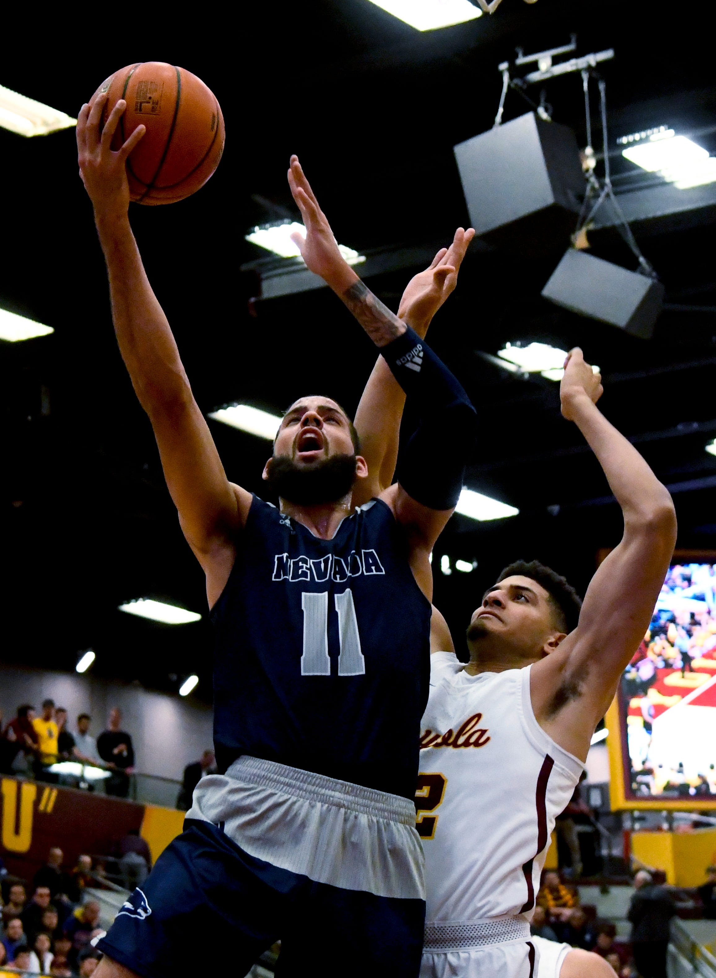 Martin twins lead No. 5 Nevada over Loyola-Chicago 79-65