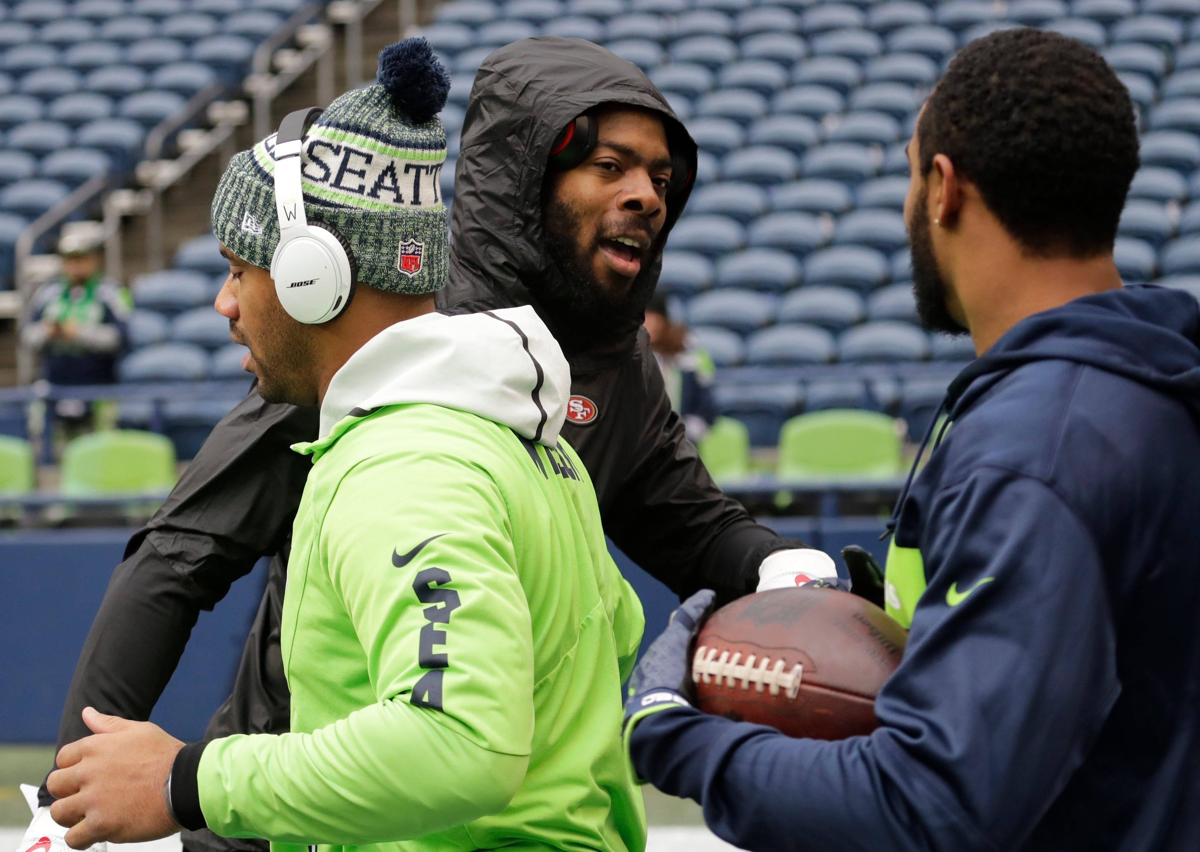 The Latest: Sherman says hey to old teammates in Seattle
