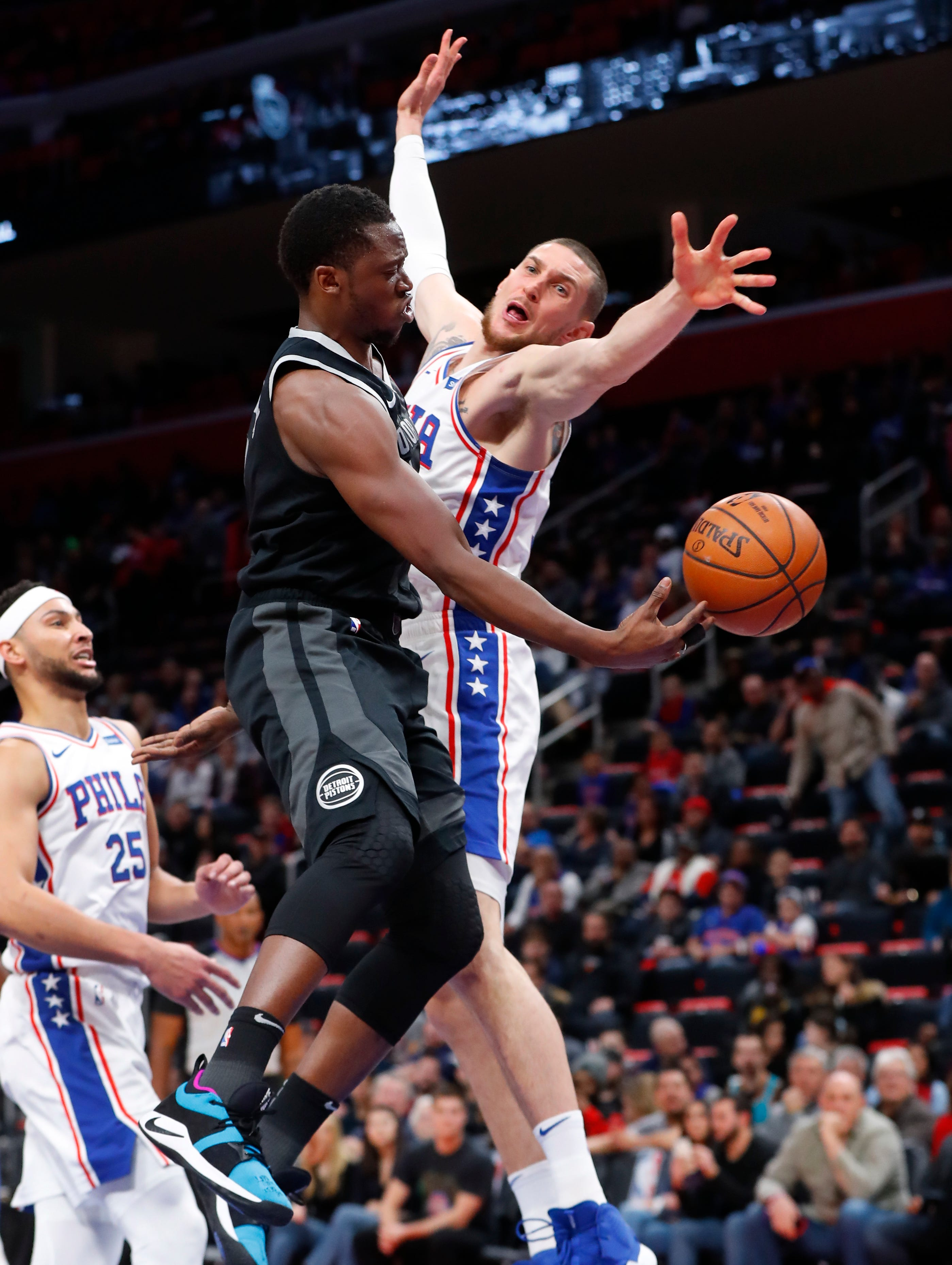 Butler, 76ers rally without Embiid, beat Pistons 117-111